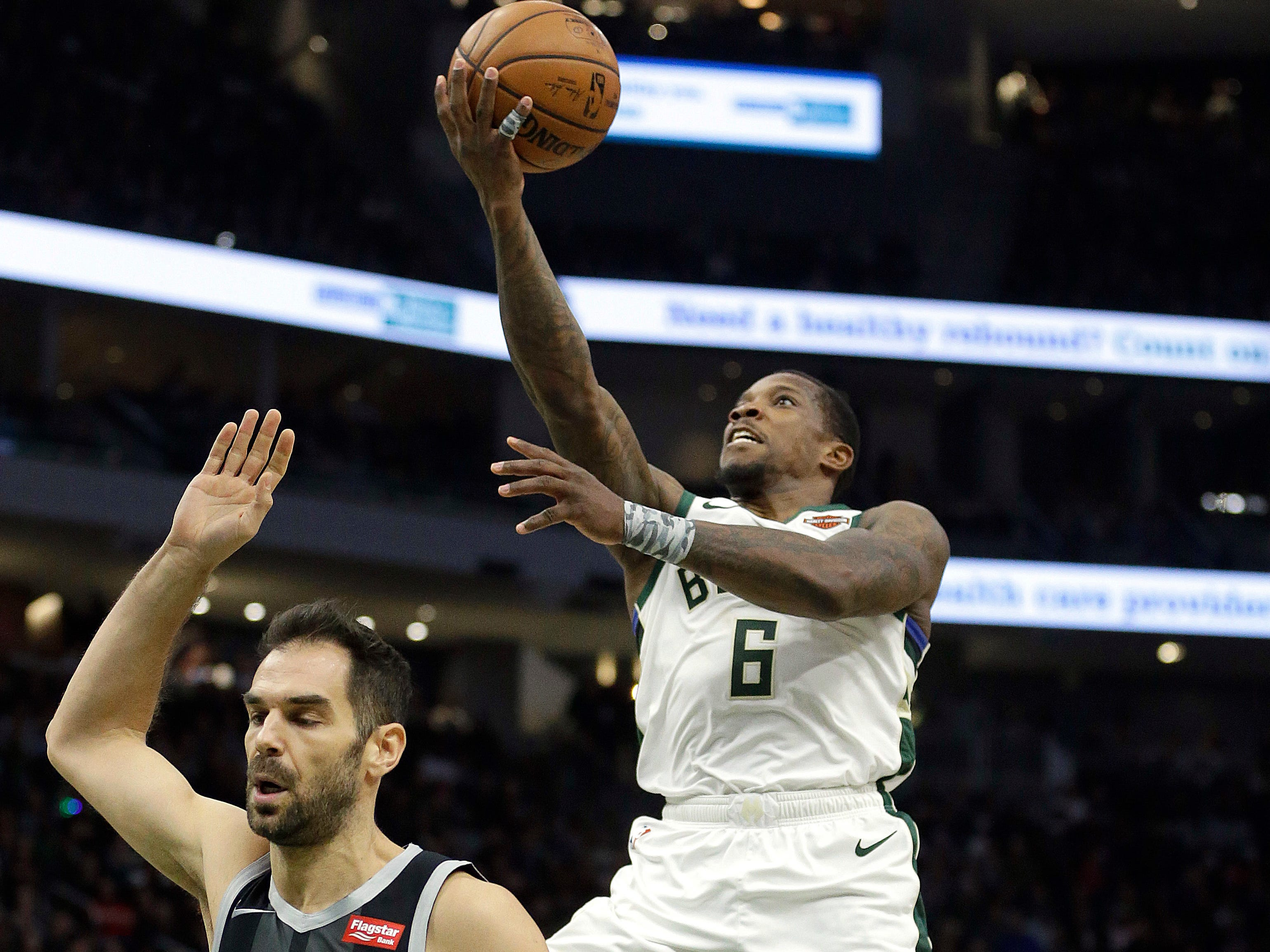 Milwaukee's Eric Bledsoe goes up for a shot in front of Detroit's Jose Calderon during the second half.
