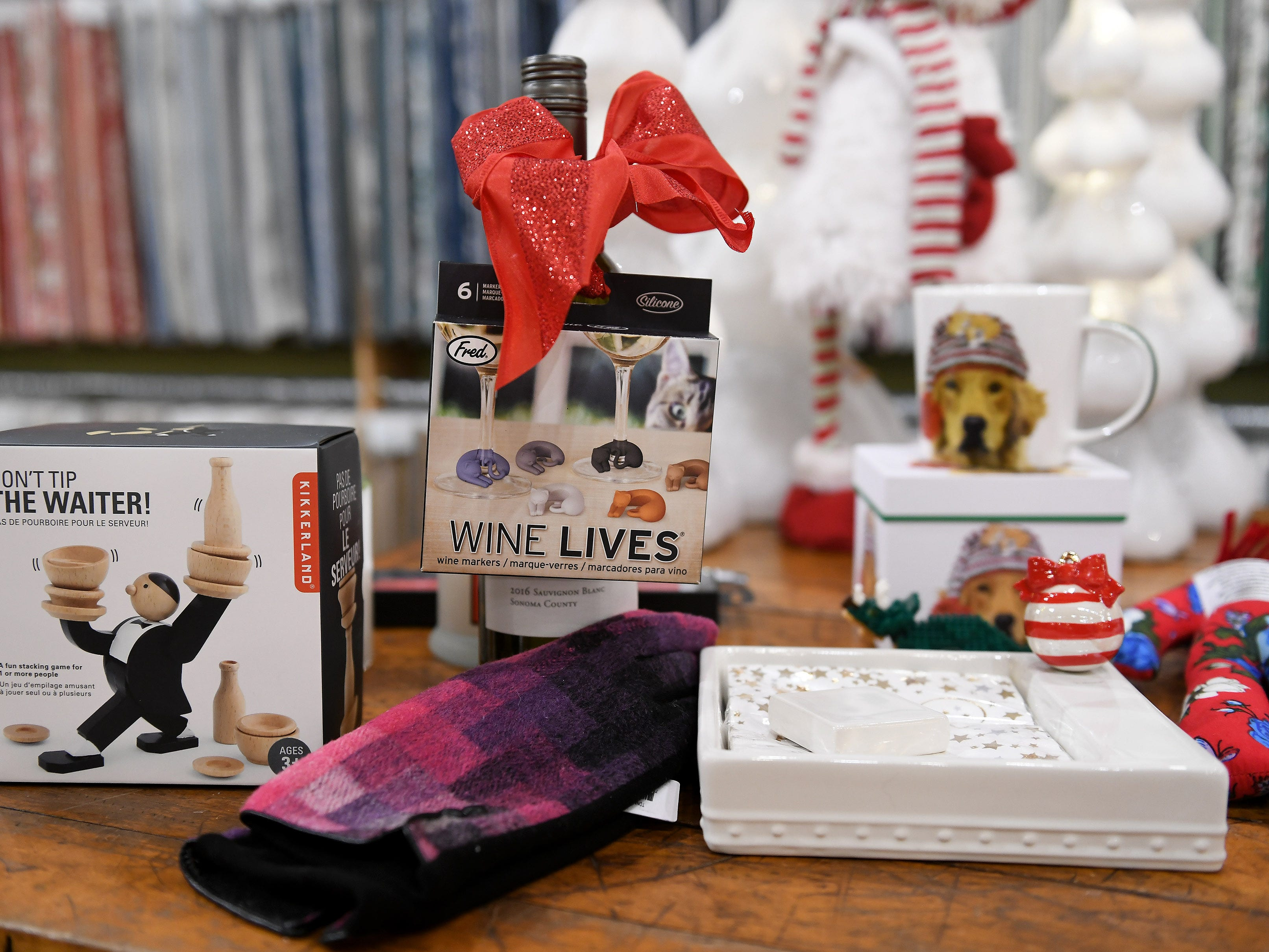 Small and fun gift ideas such as wine favors, games and gloves at Leon & Lulu.