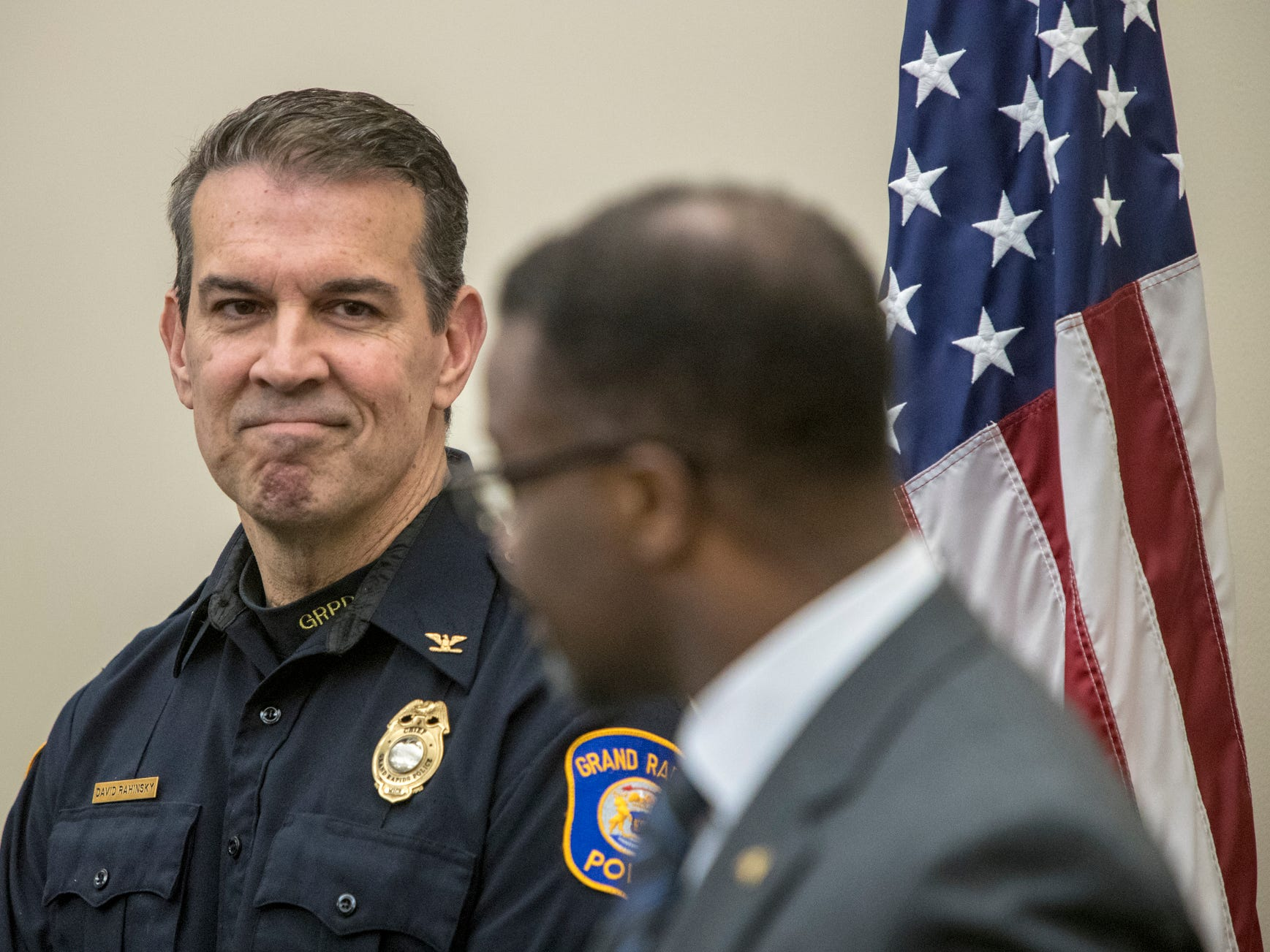 City Manager Mark Washington talks about the Grand Rapids Police Department's achievements under the leadership of Chief David Rahinsky, left, during a press conference announcing Rahinsky's retirement on Thursday, Dec. 6, 2018. Rahinsky, who took the reigns in July 2014, plans for his last day in office to be Tuesday, Dec. 18.
