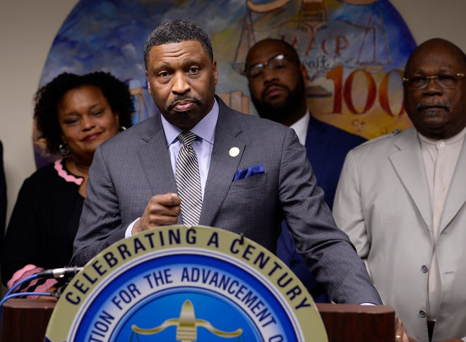 NAACP President Derrick Johnson gives his remarks during the news conference.