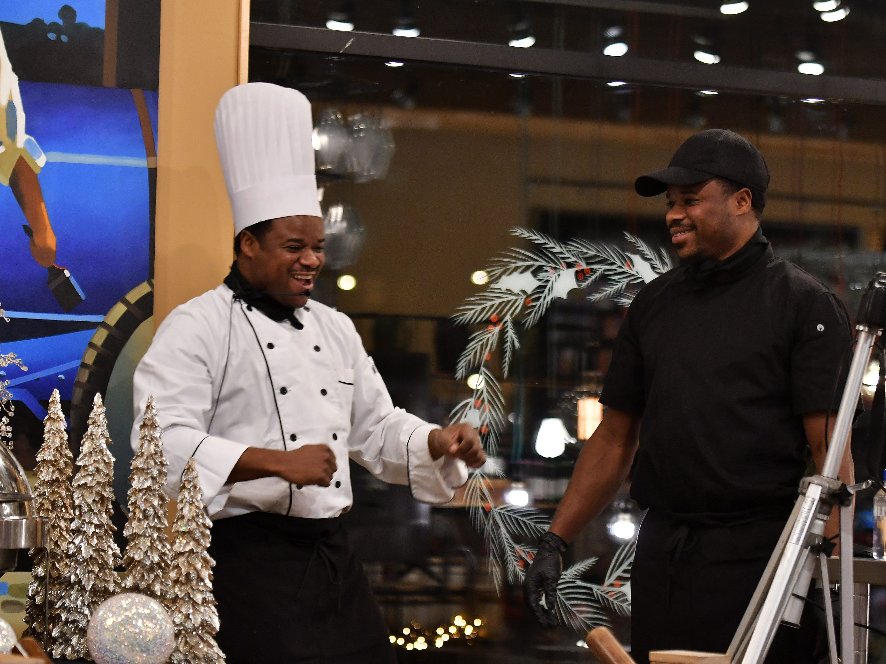 Chef Omar Mitchell, left, and his twin brother, Shimar Mitchell, both from Craft Creative Catering after they created decorative buffet tables.