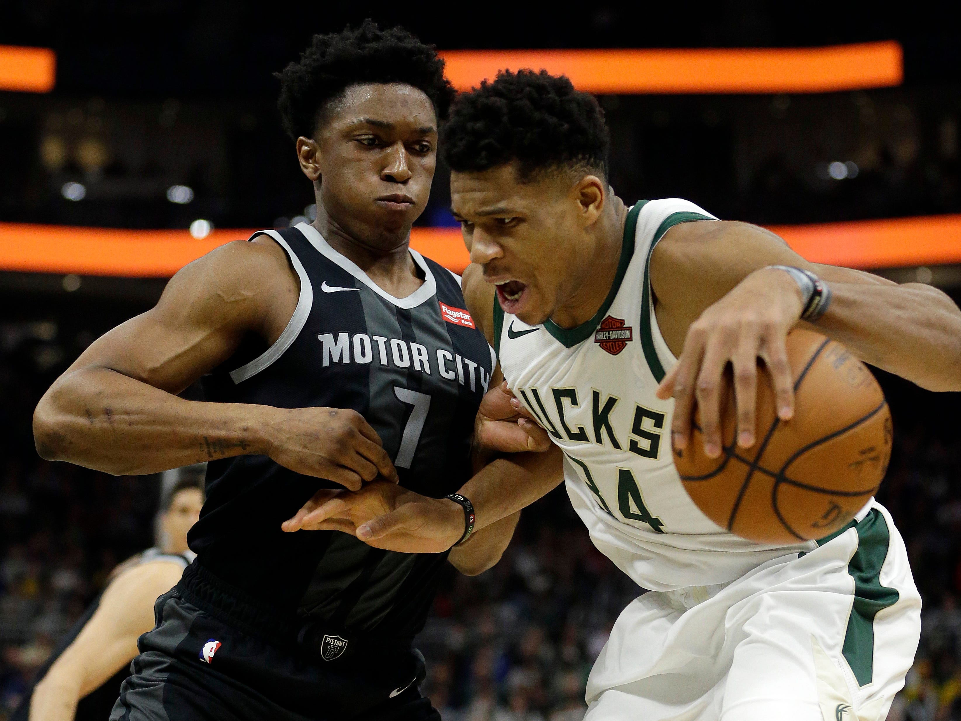 Milwaukee's Giannis Antetokounmpo, right, drives against Detroit's Stanley Johnson during the second half.