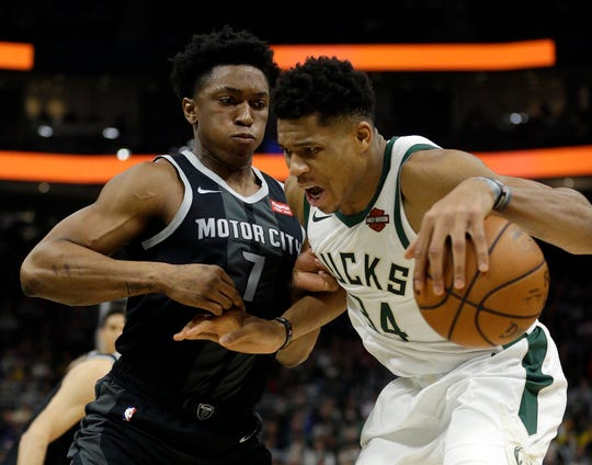 Milwaukee's Giannis Antetokounmpo, right, drives against Detroit's Stanley Johnson during the second half Wednesday.