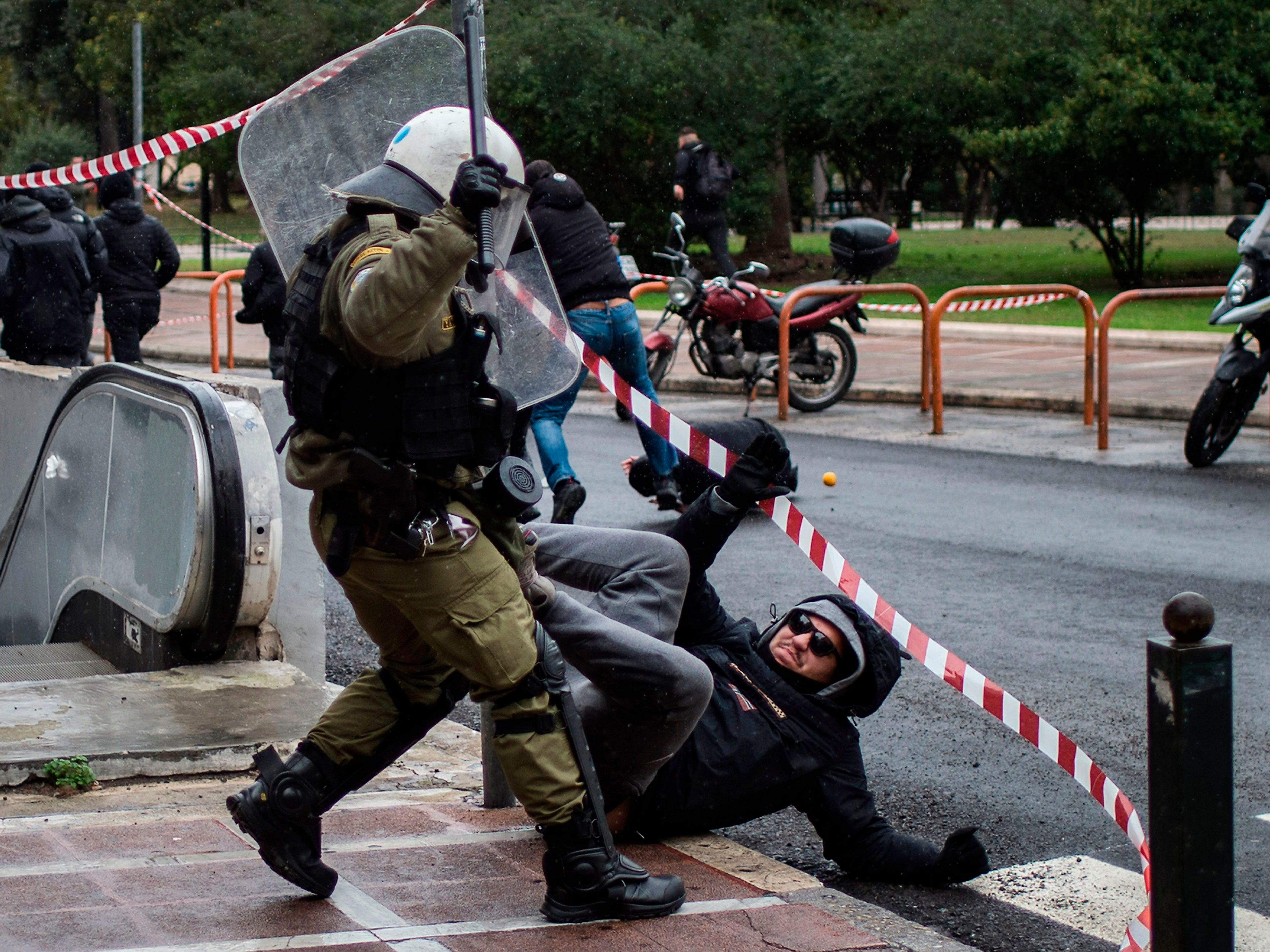 Police clash with protesters on Dec. 6, 2018 in Athens during a demonstration to mark the 10th anniversary of the fatal shooting of a teenager which sparked major riots in Greece in 2008.
