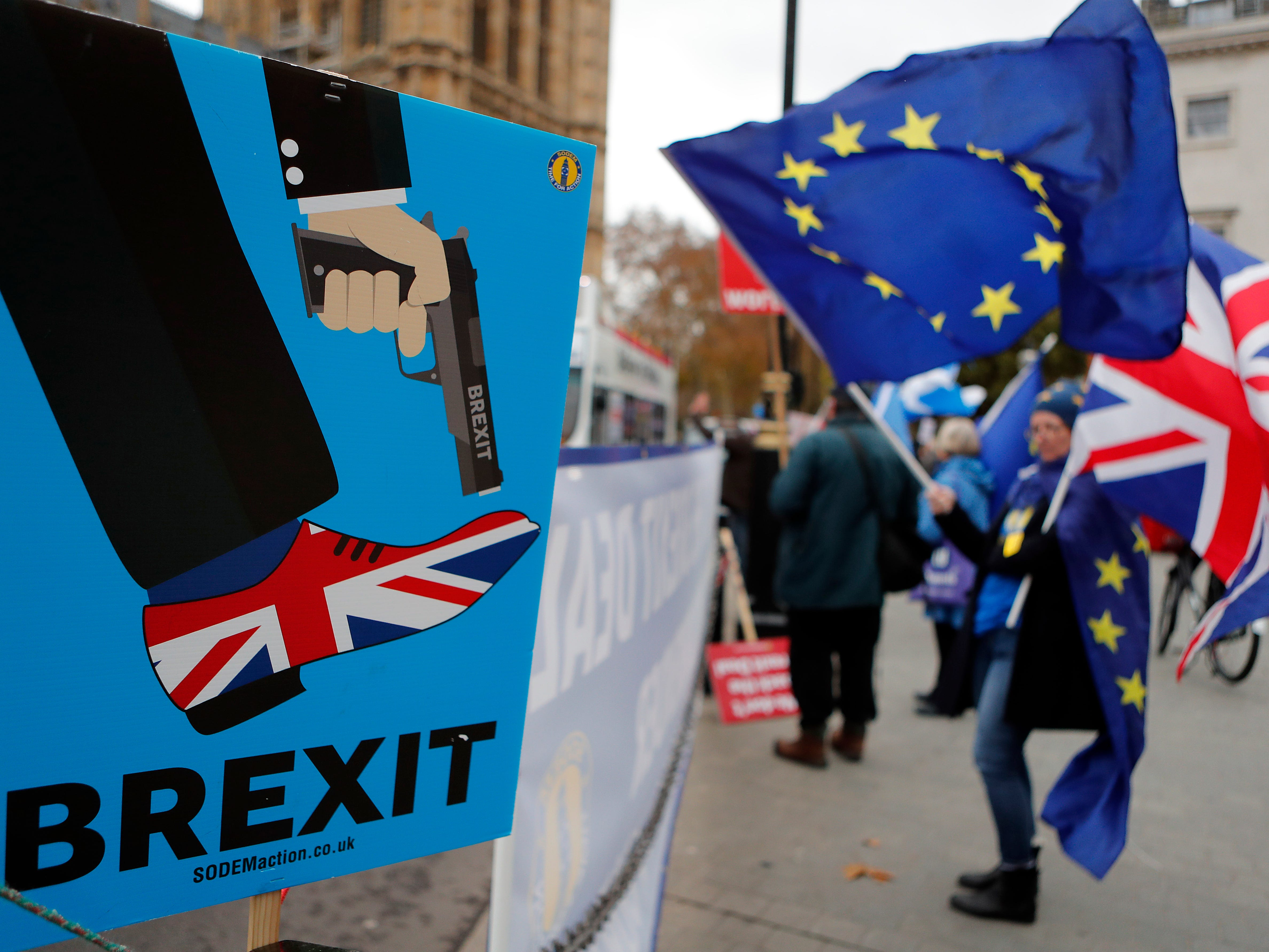 Protesters demonstrate opposite Parliament against Britain's Brexit split from Europe, in London, Thursday, Dec. 6, 2018. Prime Minister Theresa May's effort to win support for her Brexit agreement comes amid reports in British newspapers that Parliament could reject the deal by more than 100 votes.