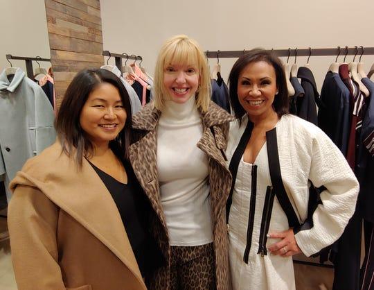 Doris Gilles, left, Jennifer Granger, and Jessie Beld-Elliott host the fundraising shopping event at MaxMara in Somerset Collection.