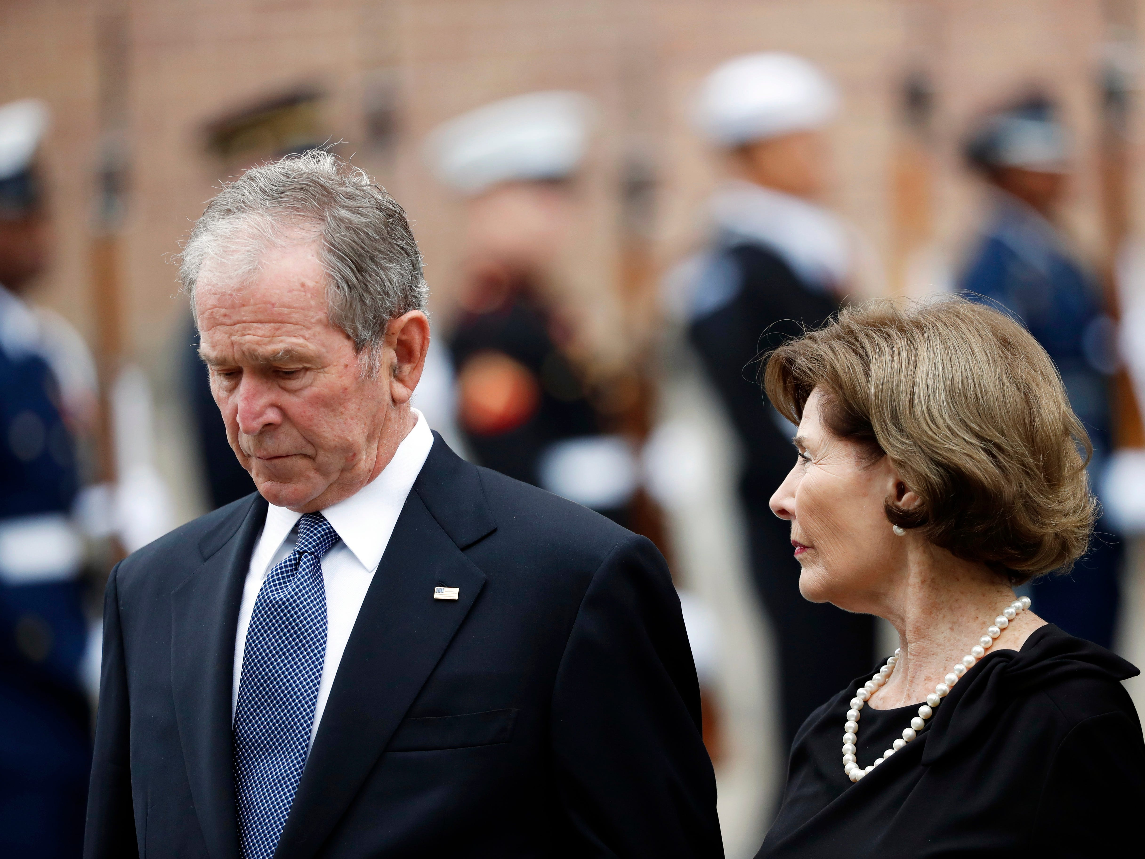 Former President George W. Bush and his wife, Laura Bush, leave St. Martin's Episcopal Church in Houston after the funeral for his father, former President George H.W. Bush, on Thursday, Dec. 6, 2018.