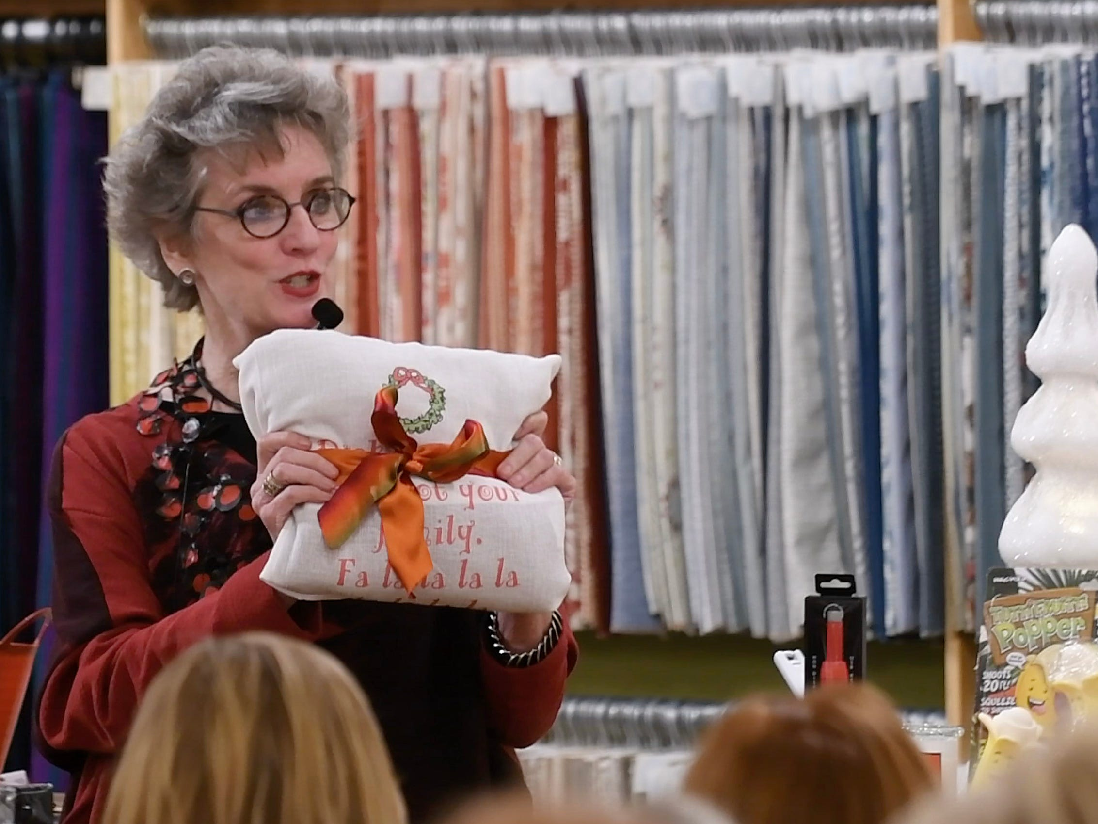 Mary Liz Curtin from Leon & Lulu and The Show talks about layering holiday gifts like this dishtowel that has a gift inside.