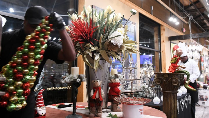 Twin brothers, Shimar Mitchell, left, and chef Omar Mitchell prepare two very different designs for a buffet table at the holiday installment of The Detroit News Dish & Design event at The Show in Clawson, Wednesday night, December 5, 2018.