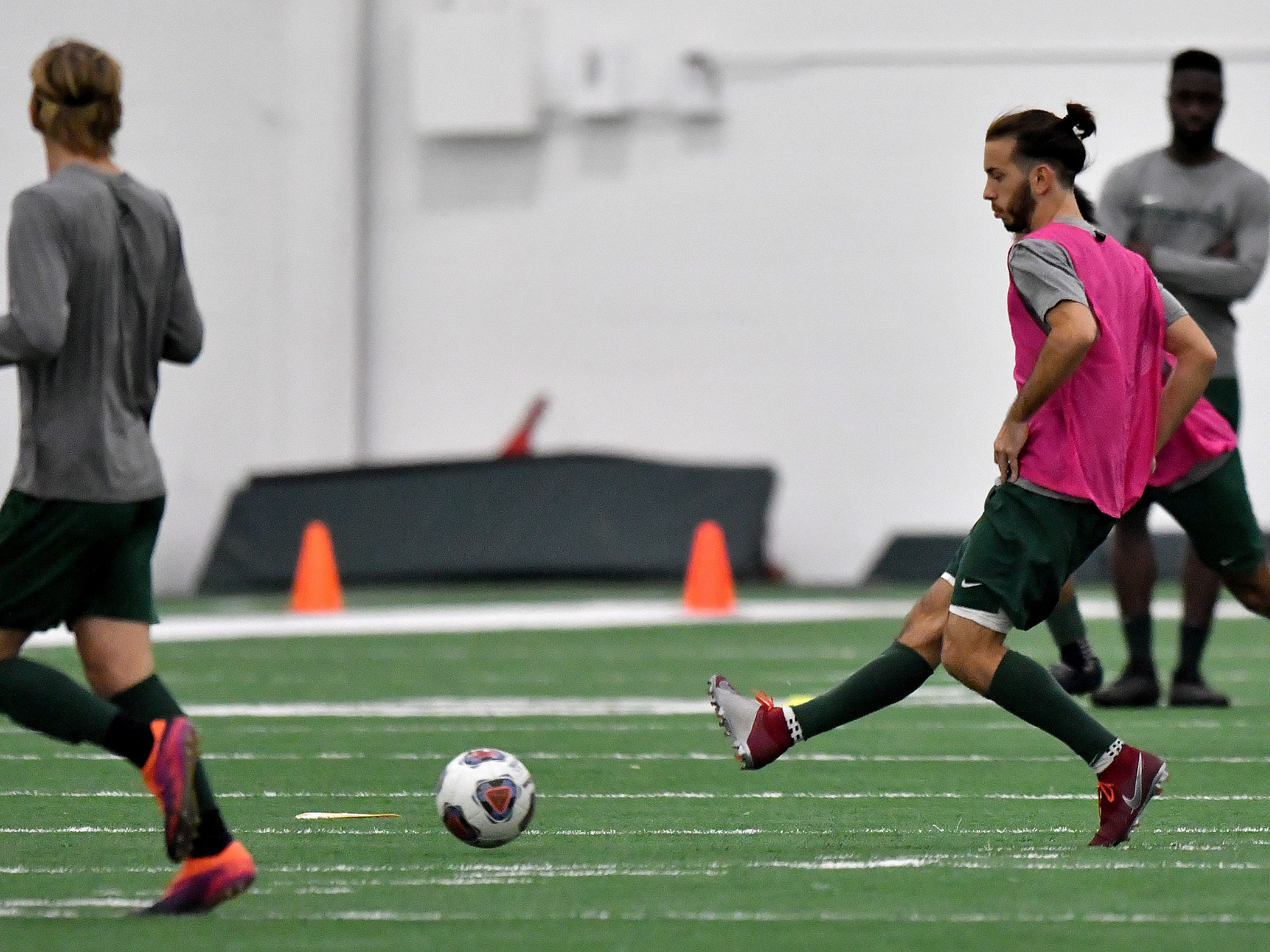 Giuiseppe Barone passes the ball during drills at the Duffy Daugherty Building.
