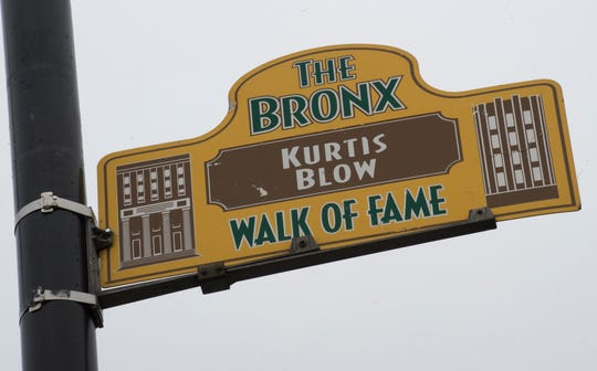 A sign honoring hip-hop pioneer Kurtis Blow hangs from a lamp post as part of the Bronx Walk of Fame in the Bronx March 7, 2017 in New York.