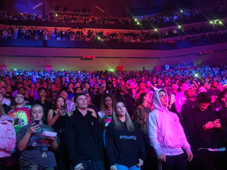 Fans watch Travis Scott perform.