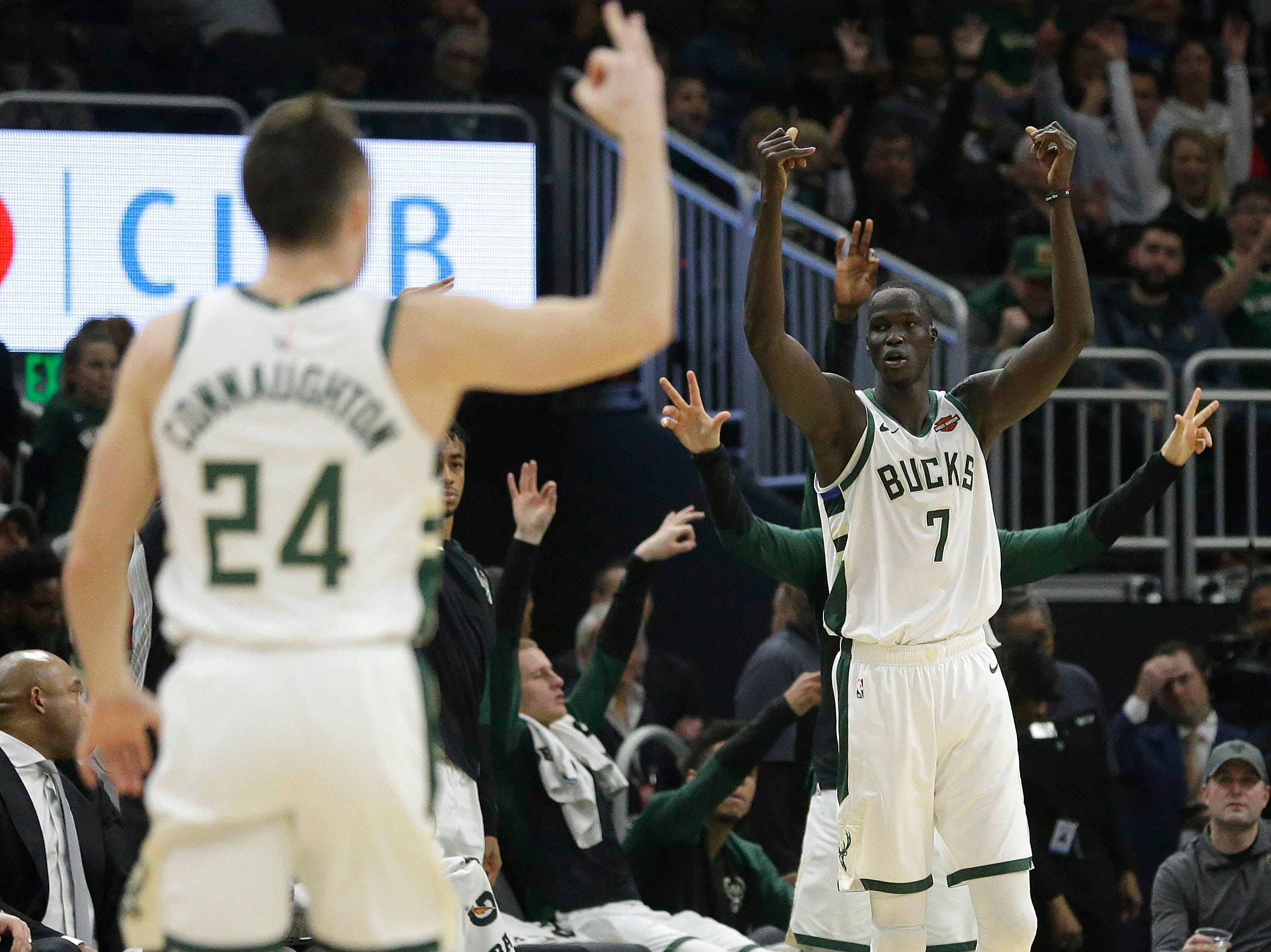 Milwaukee's Thon Maker (7) reacts after making a 3-pointer during the first half.