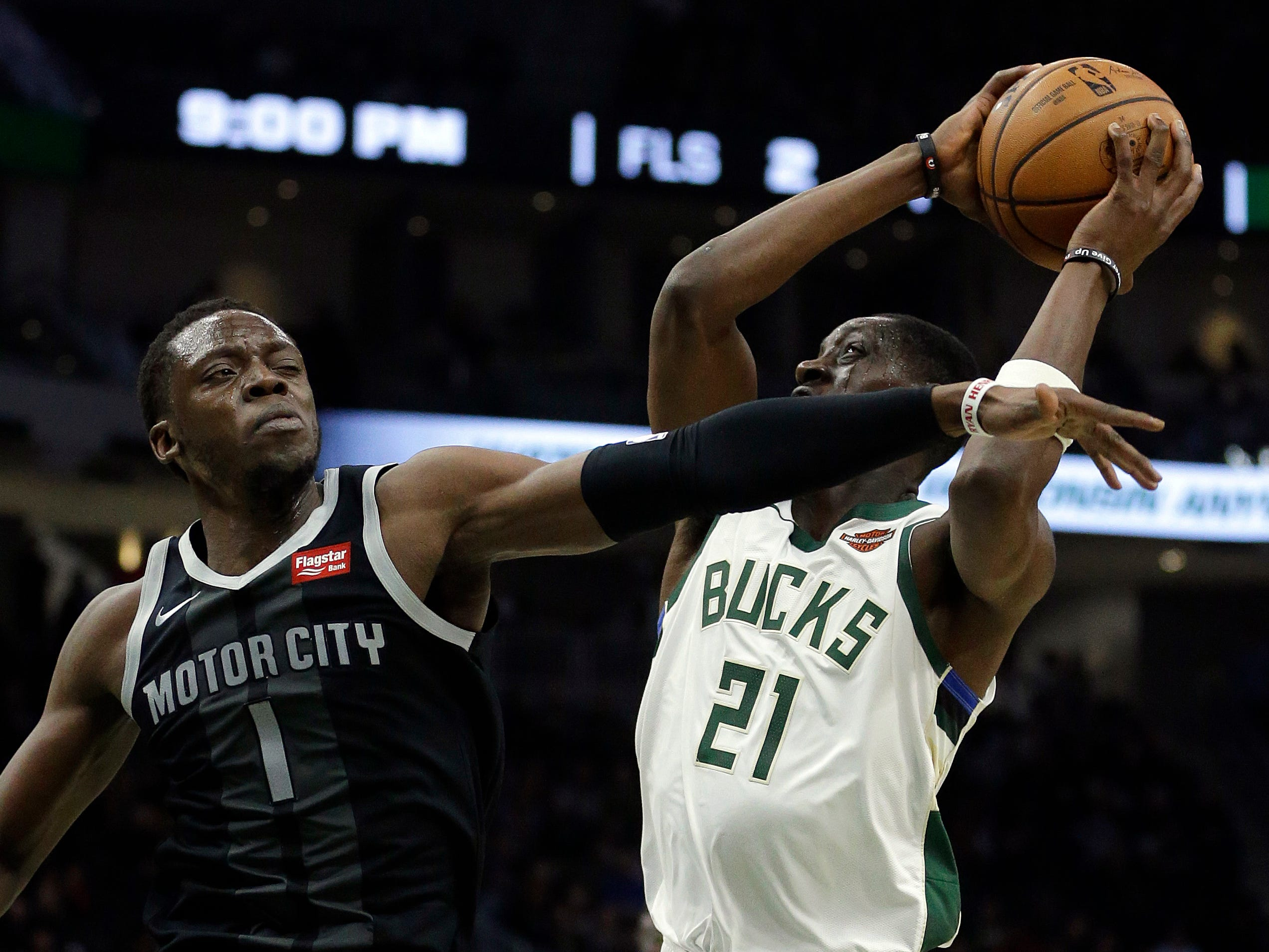 Milwaukee's Tony Snell is fouled by Detroit's Reggie Jackson.