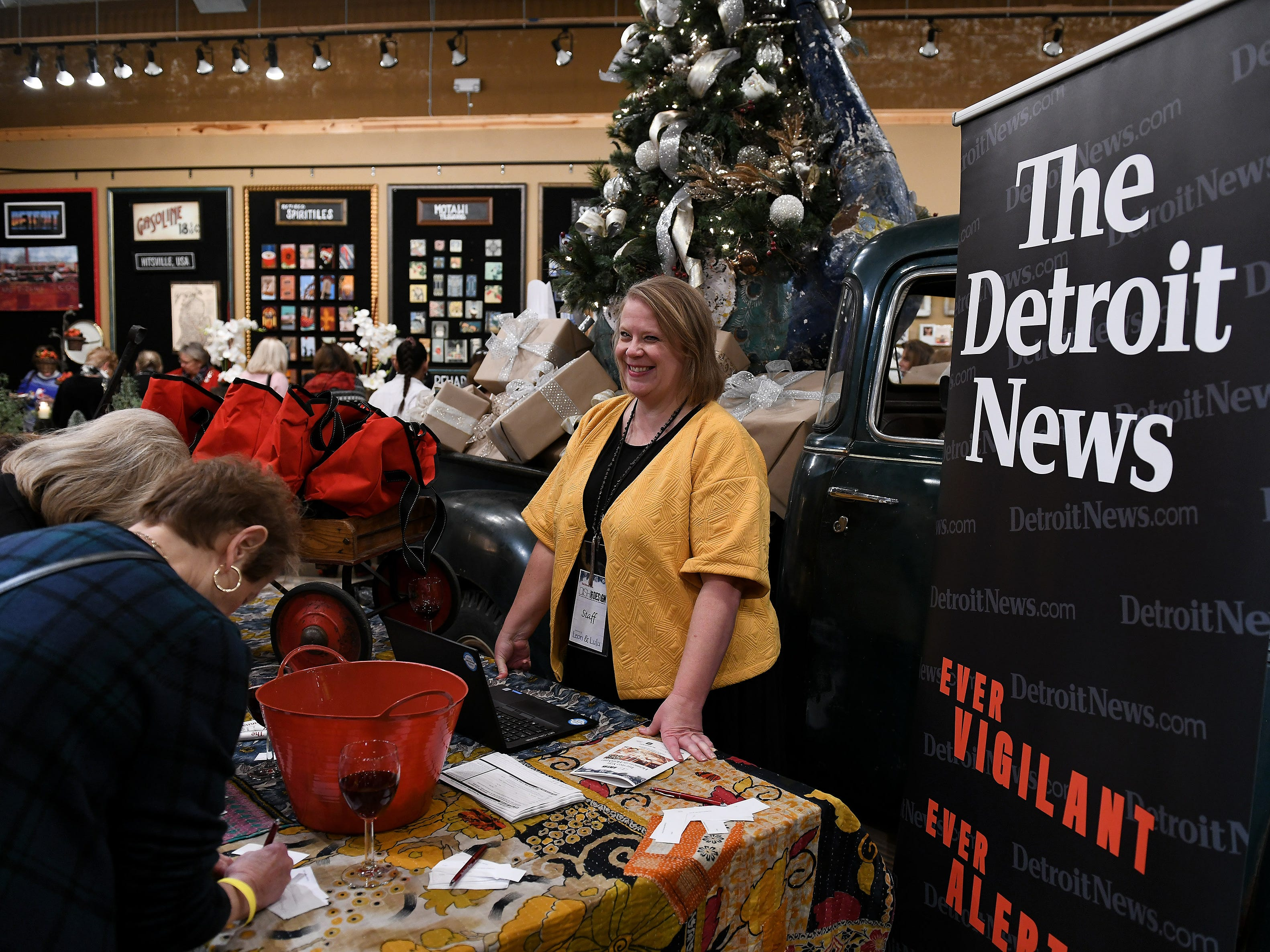Julia Stevenson from The Detroit News consumer sales department takes down names for door prizes.