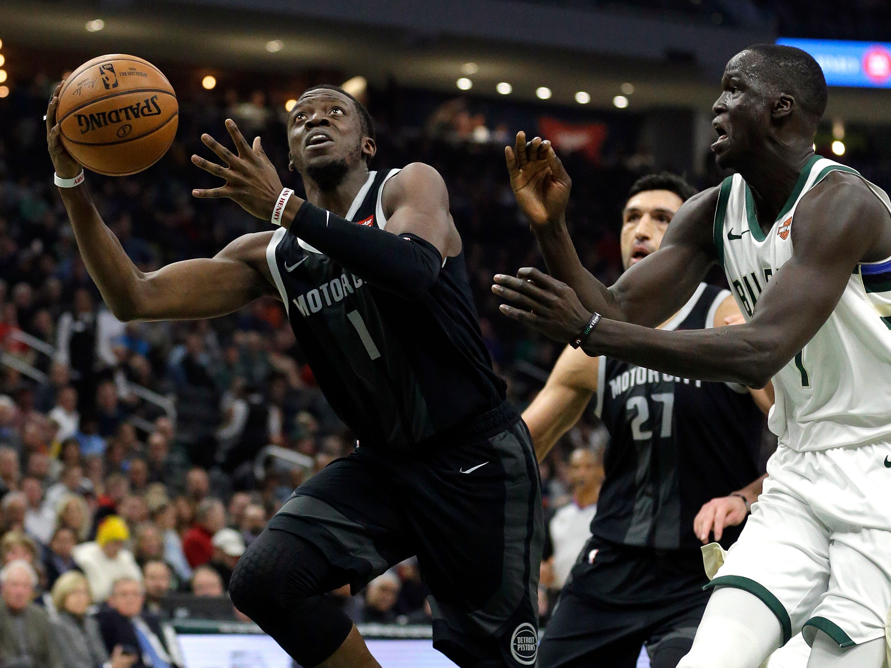 Detroit's Reggie Jackson puts up a shot past Milwaukee's Thon Maker during the first half.