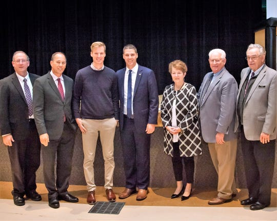 Wade Owlett, a teacher at Clark Wood Elementary School, was recently named the 2018-19 Monsanto Fund Rural Teacher of the Year by the National Rural Education Association. From left are Tioga County Commissioner Mark Hamilton, Sen. Joe Scarnati, Wade Owlett, state Rep. Clint Owlett, Northern Tioga School District Superintendent Diana Barnes, and Tioga County Commissioners Roger Bunn and Erick Coolidge.