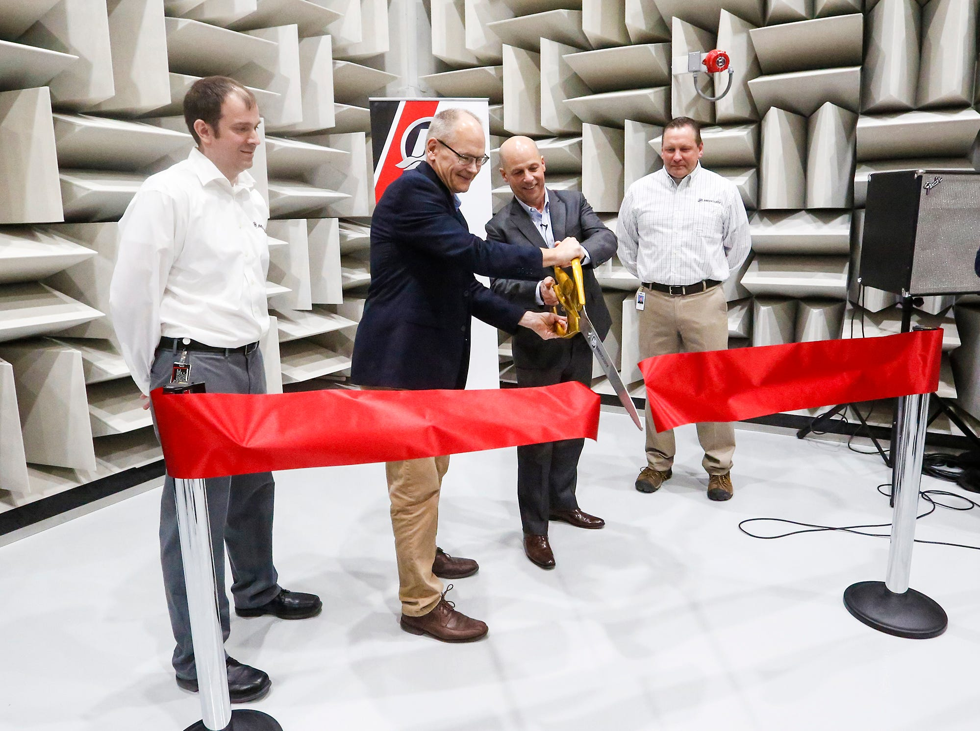 Mercury Marine personnel Andrew Waisanen, John Pfeifer, Tim Reid and Doug Czaikowski take part in a ribbon-cutting Thursday, Dec. 6, 2018, for Mercury's new NVH facility in Fond du Lac.