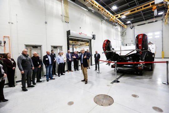 Mercury Marine's Tim Reid talks to guests Thursday, Dec. 6, 2018, in one of the rooms at their new NVH facility in Fond du Lac.