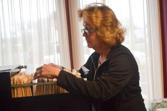 "Domestic Violence Victims' Advocate Wynn Schell searches through the files of the hundreds of clients she has helped in Sandusky County. This year alone, she has helped nearly 100 people living in domestic violence situations. Some of them find independent housing, some live temporarily at Liberty Center, and some stay with their partners while they work through the issues. ""I support the women in the environment they choose to live in,"" she said."