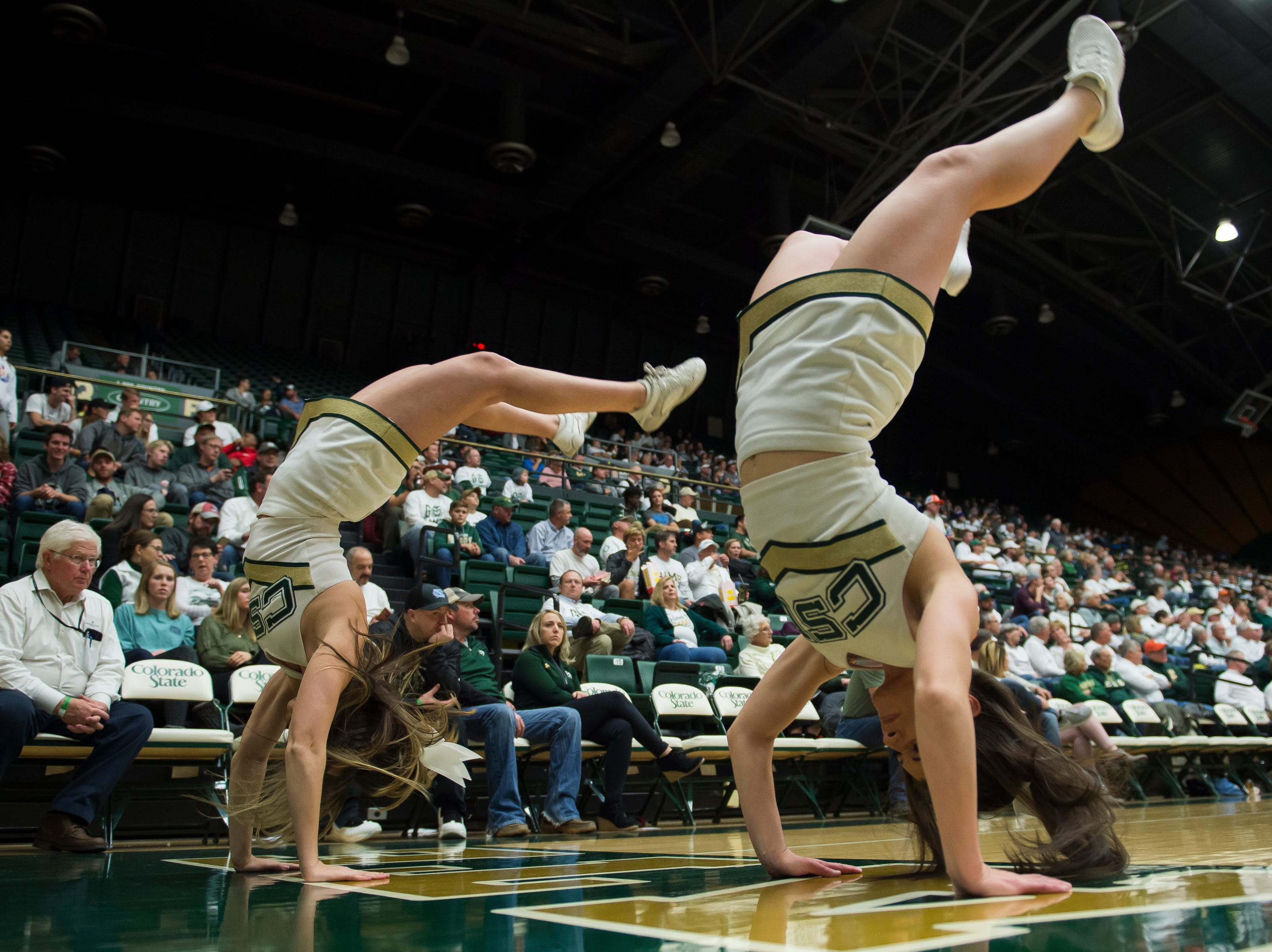 Colorado State University cheerleaders do handsprings to celebrate a free throw during a gam against Arkansas on Wednesday, Dec. 5, 2018, Moby Arena in Fort Collins, Colo.