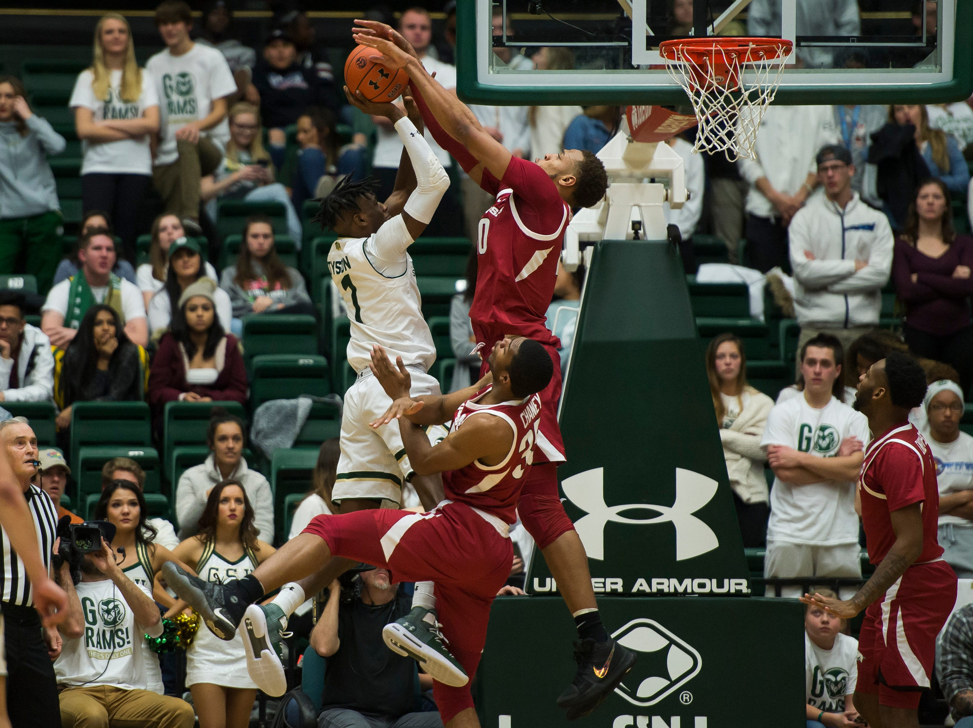 Arkansas sophomore forward Daniel Gafford (10) blocks a shot by Colorado State University junior forward Zo Tyson (1) on Wednesday, Dec. 5, 2018, Moby Arena in Fort Collins, Colo.
