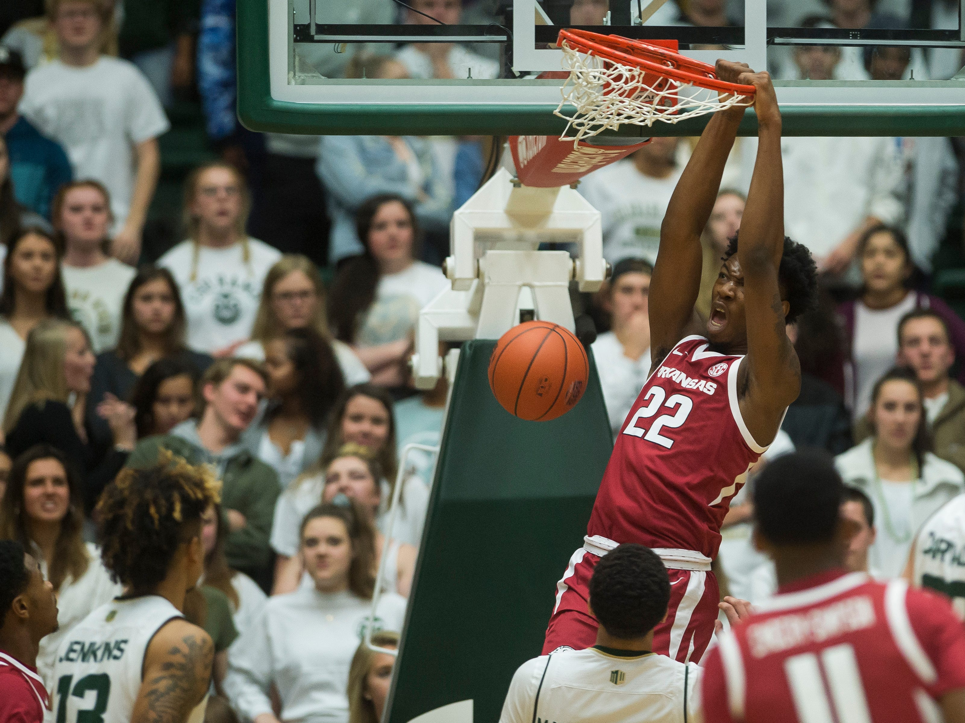 Arkansas sophomore forward Gabe Osabuohien (22) dunks on Colorado State University on Wednesday, Dec. 5, 2018, Moby Arena in Fort Collins, Colo.