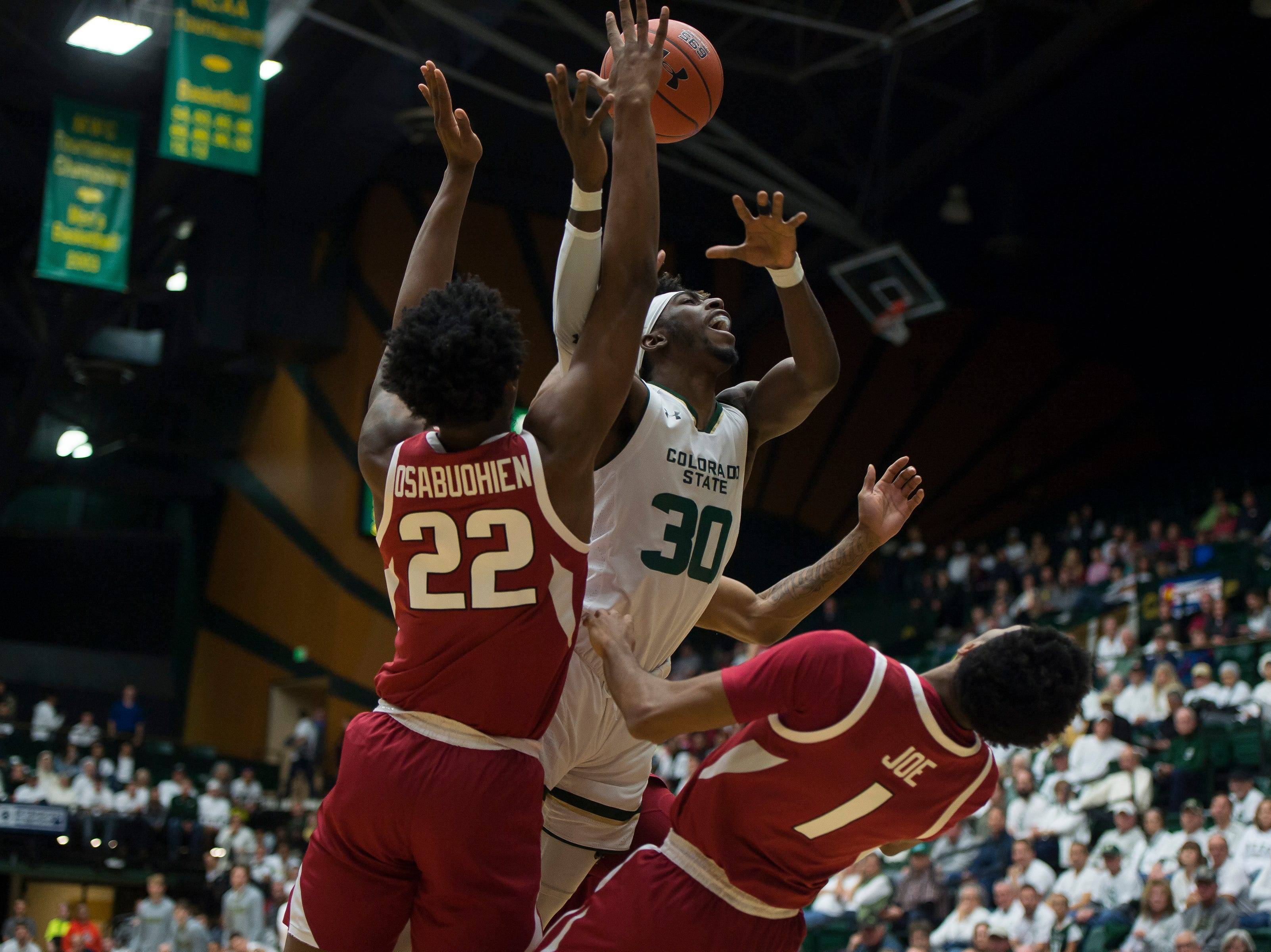 Colorado State University junior guard Kris Martin (30) is fouled during a game against Arkansas on Wednesday, Dec. 5, 2018, Moby Arena in Fort Collins, Colo.