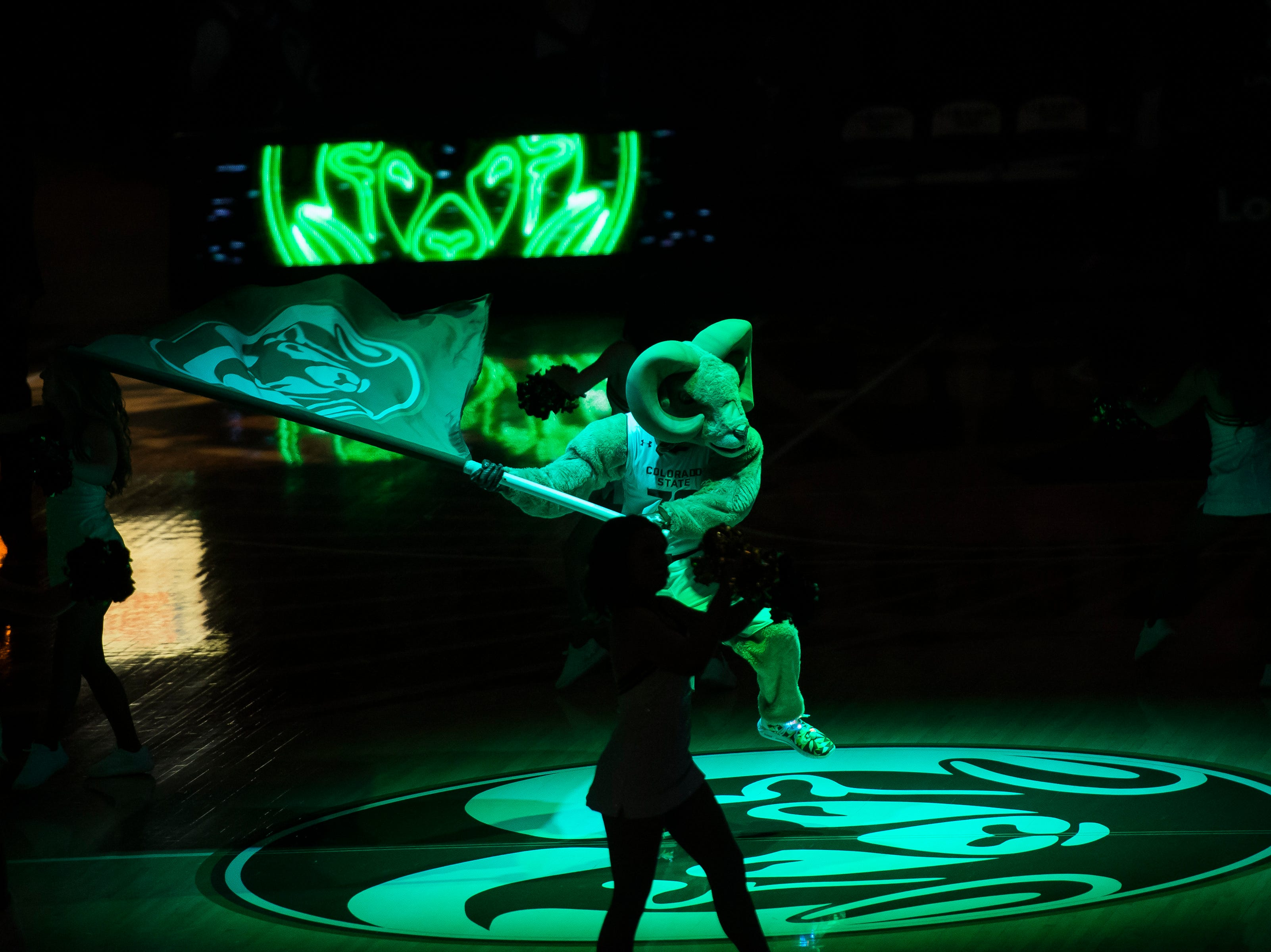 Colorado State University mascot Cam the Ram waves a flag at half-court before a game against Arkansas on Wednesday, Dec. 5, 2018, Moby Arena in Fort Collins, Colo.
