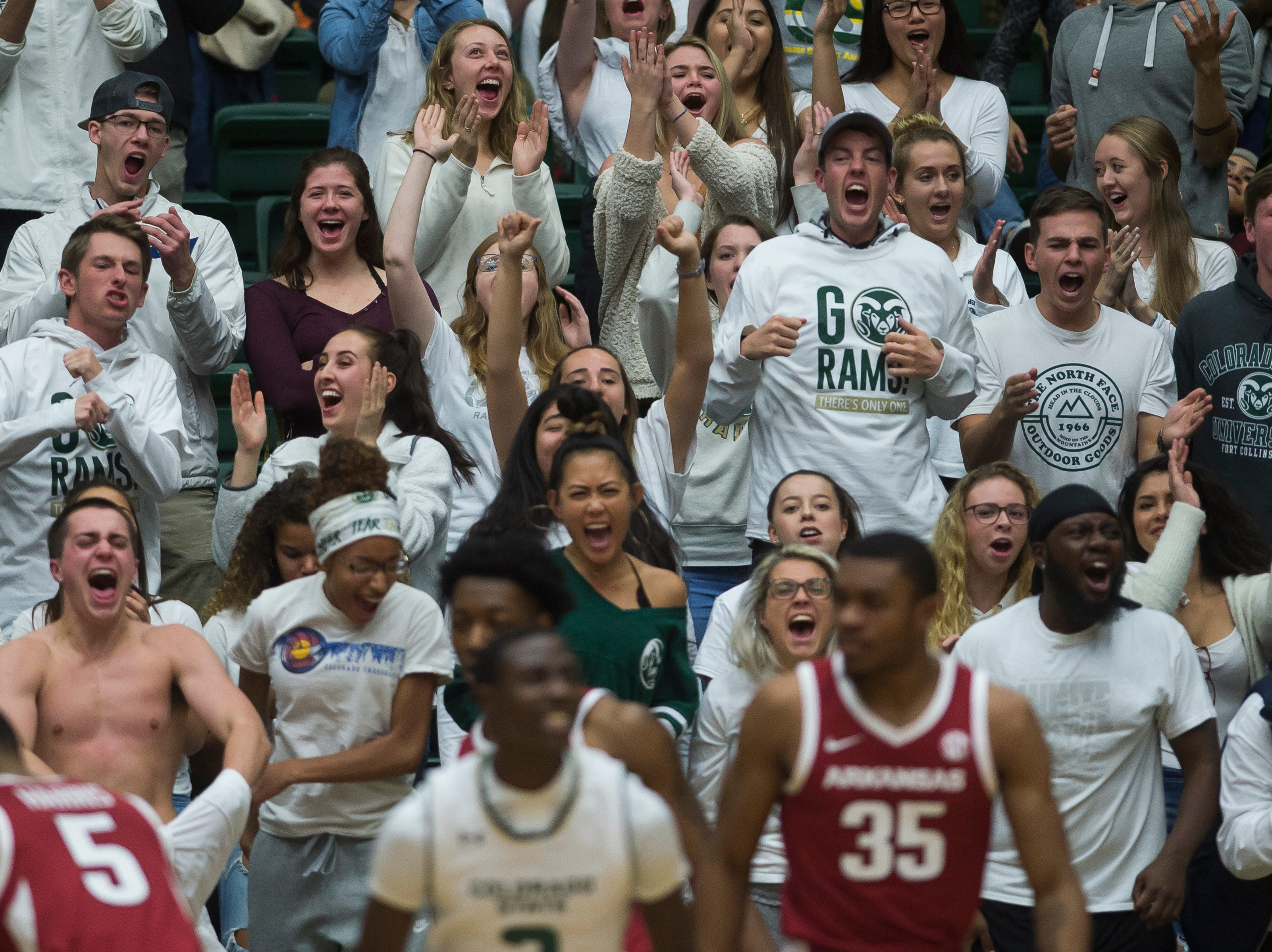 The Colorado State University student section reacts to a play during a game against Arkansas on Wednesday, Dec. 5, 2018, Moby Arena in Fort Collins, Colo.