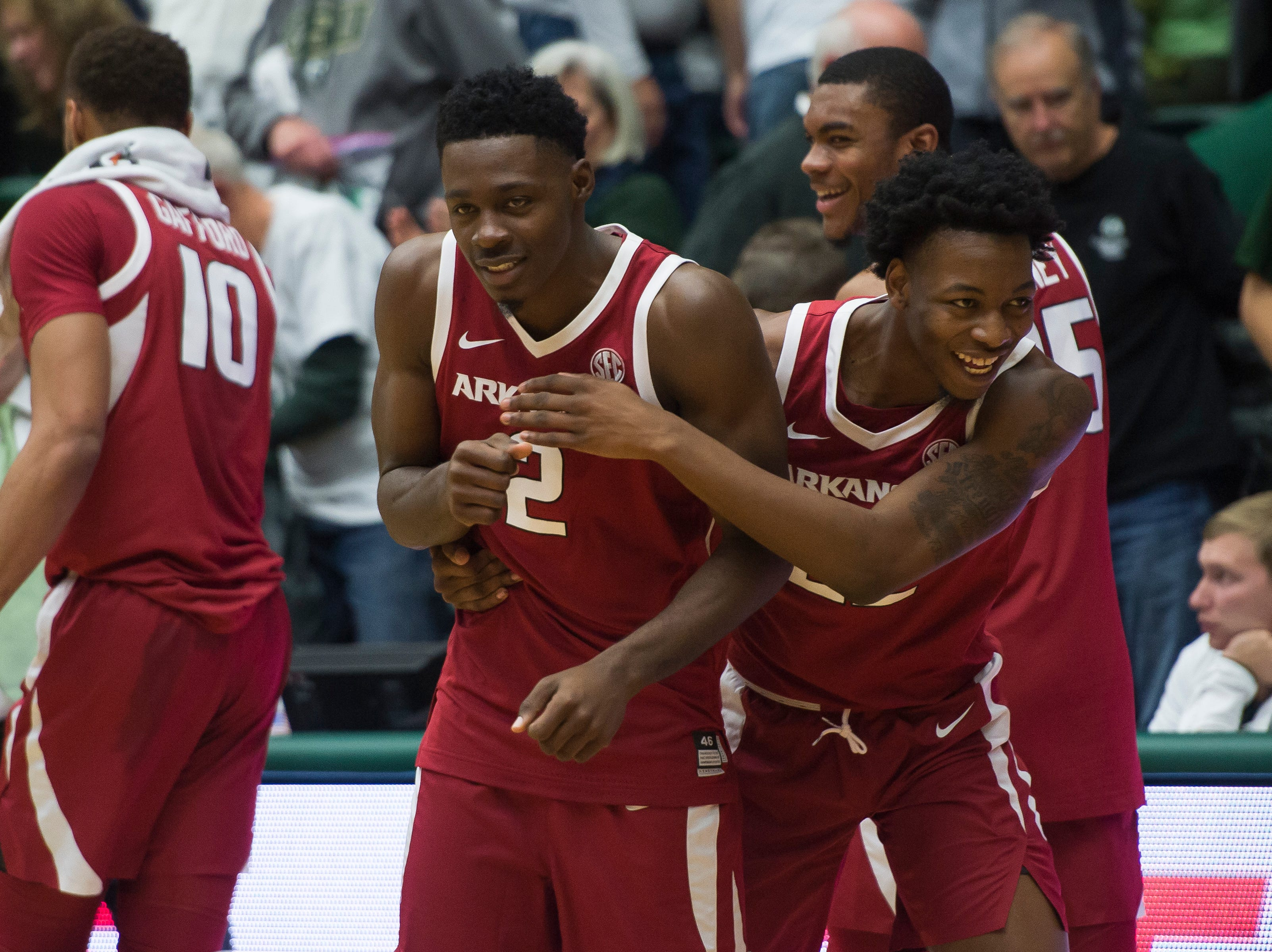 Arkansas sophomore forward Gabe Osabuohien (22) hugs junior forward Adrio Bailey (2) after beating Colorado State University on Wednesday, Dec. 5, 2018, Moby Arena in Fort Collins, Colo.