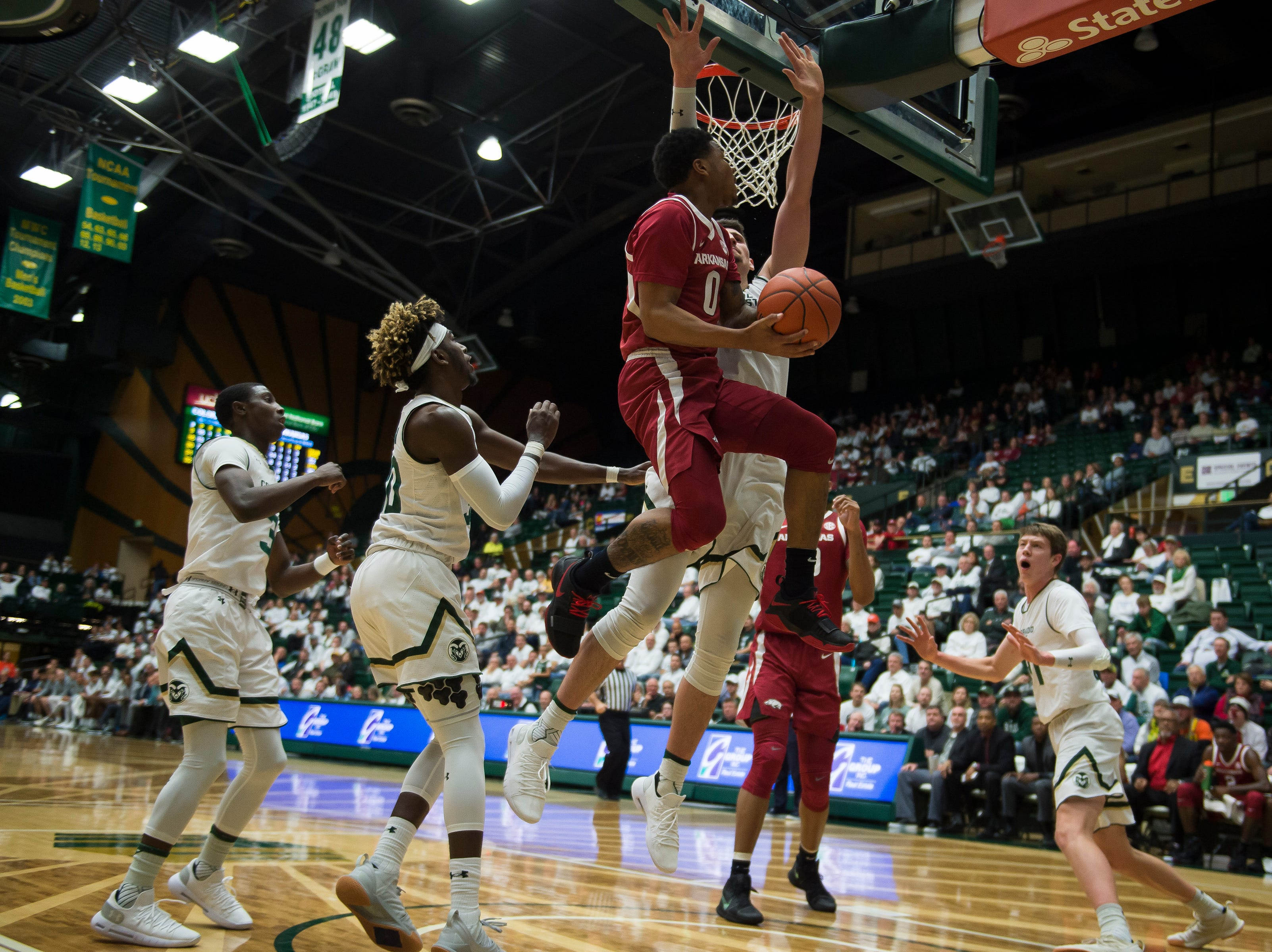 Colorado State University junior center Nico Carvacho (32) blocks out Arkansas freshman guard Desi Sills (0) on Wednesday, Dec. 5, 2018, Moby Arena in Fort Collins, Colo.