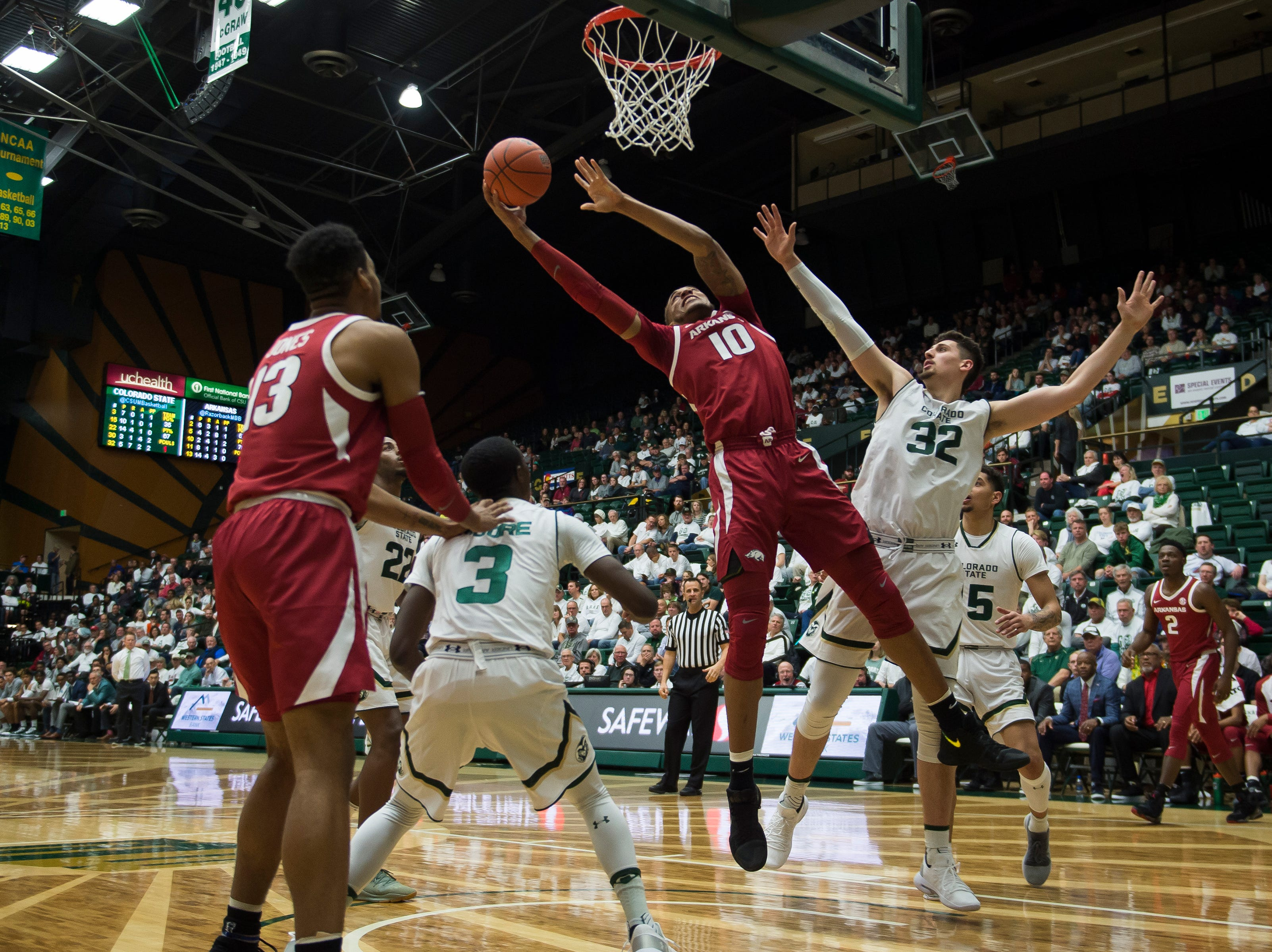 Arkansas sophomore forward Daniel Gafford (10) stretches out for a shot past Colorado State University junior center Nico Carvacho (32) on Wednesday, Dec. 5, 2018, Moby Arena in Fort Collins, Colo.