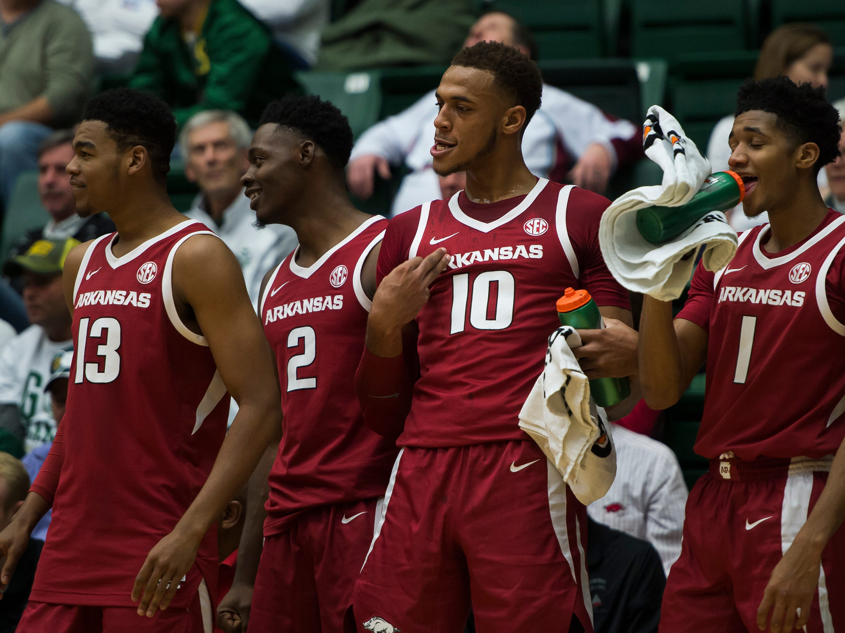 The Arkansas bench reacts toward the end of a win over Colorado State University on Wednesday, Dec. 5, 2018, Moby Arena in Fort Collins, Colo.
