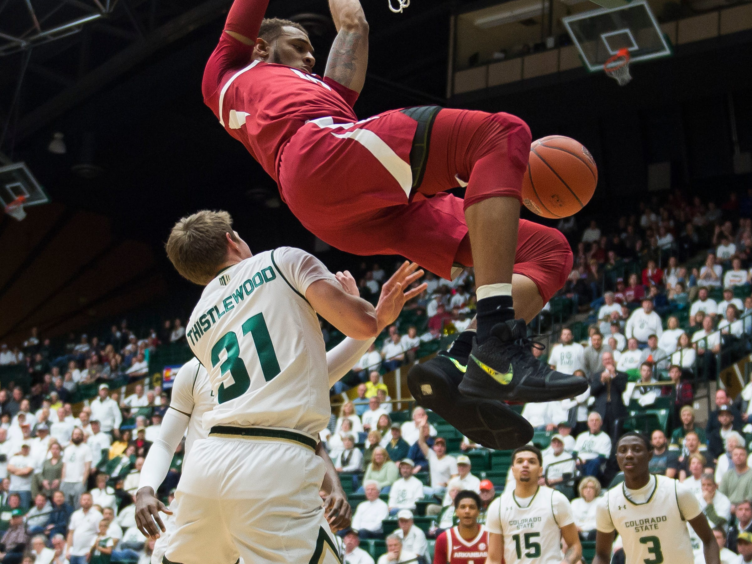 Arkansas sophomore forward Daniel Gafford (10) dunks over Colorado State University freshman forward Adam Thistlewood (31) on Wednesday, Dec. 5, 2018, Moby Arena in Fort Collins, Colo.