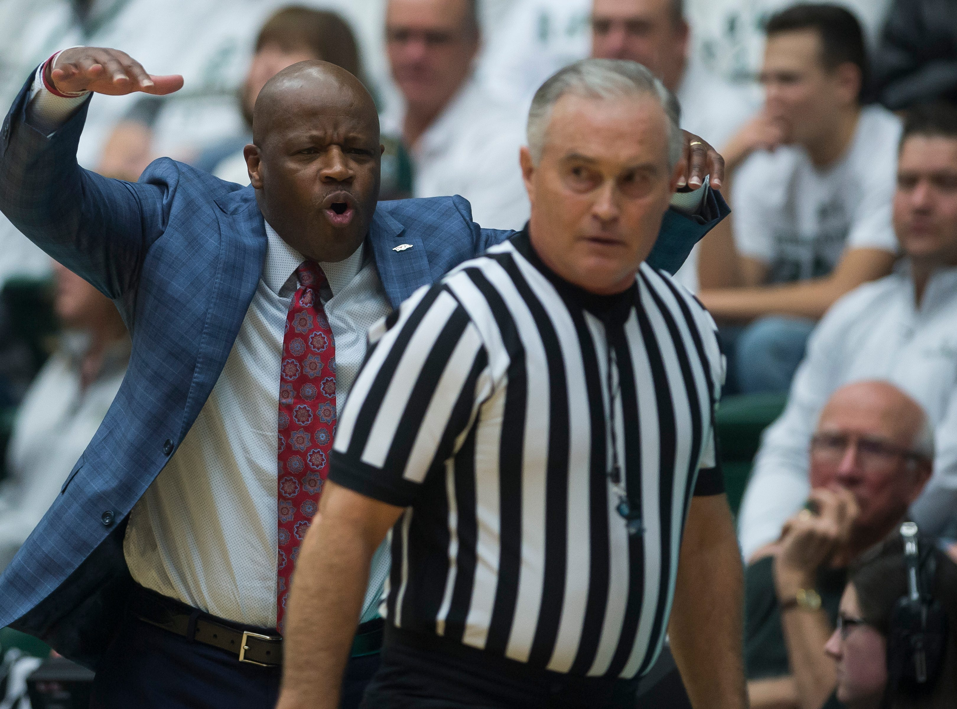 Arkansas head coach Mike Anderson talks to an official during a game against Colorado State University on Wednesday, Dec. 5, 2018, Moby Arena in Fort Collins, Colo.