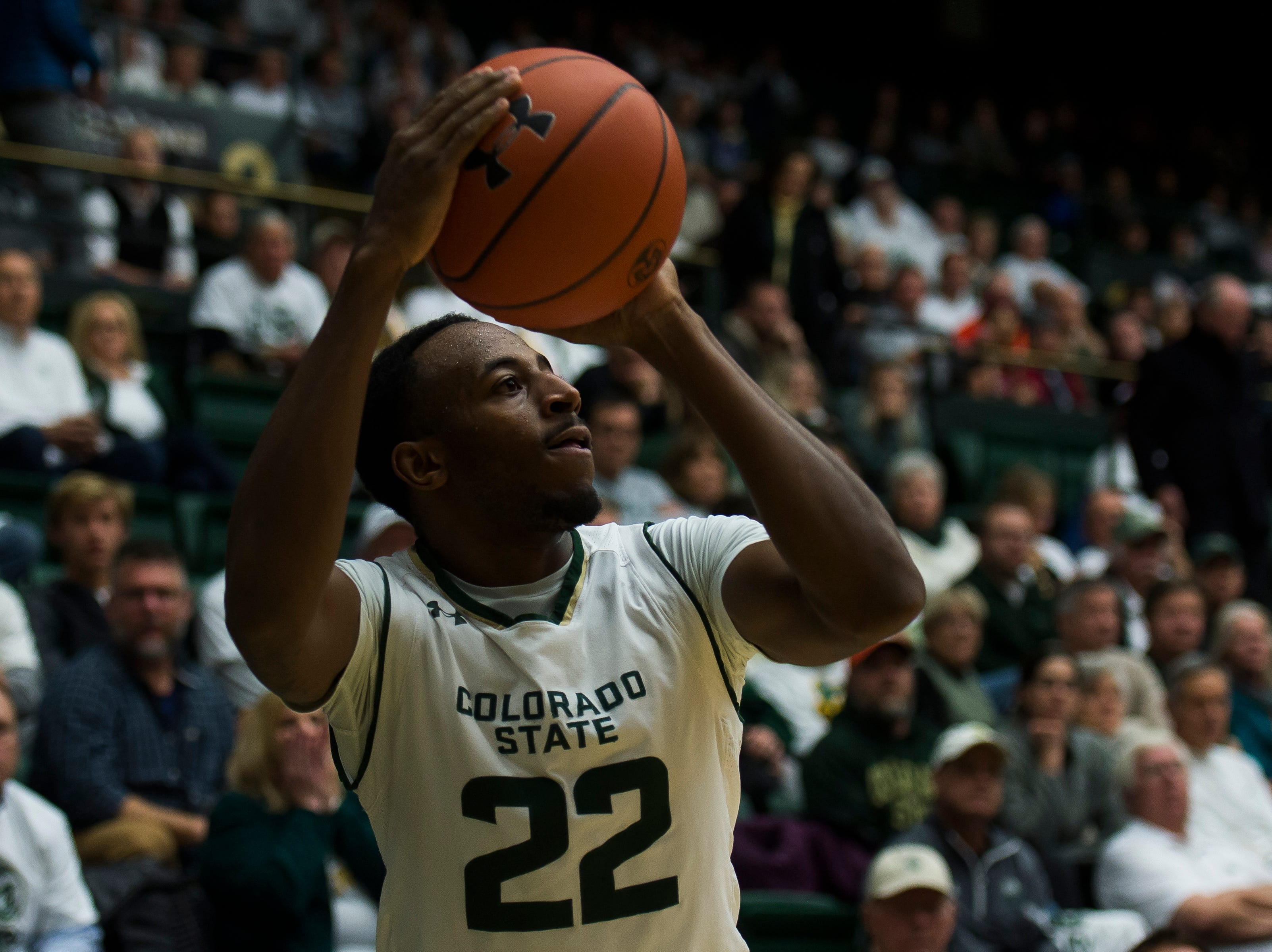 Colorado State University senior guard J.D. Paige (22) attempts three during a game against Arkansas on Wednesday, Dec. 5, 2018, Moby Arena in Fort Collins, Colo.