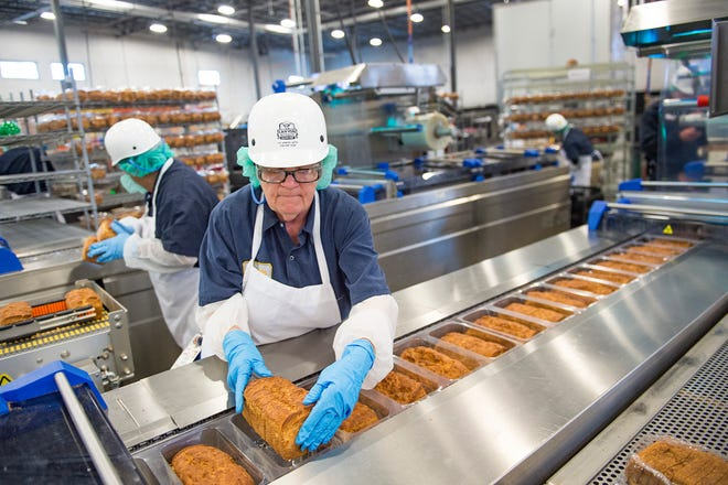 Jennelle Buhr loads loaves of gluten-free bread into packaging designed to keep it fresh on the factory line at Canyon Bakehouse in Johnstown on Thursday, December 6, 2018. The more than 165,000 square-foot facility ships products to all 50 states and is one of the largest gluten-free bakeries in the country.