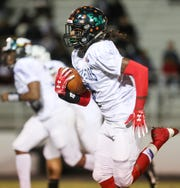South Fort Myers High School's Freddie Ward (South) returns an interception for a touchdown against the North team during the Rotary South All-Star Classic on Wednesday in Fort Myers.