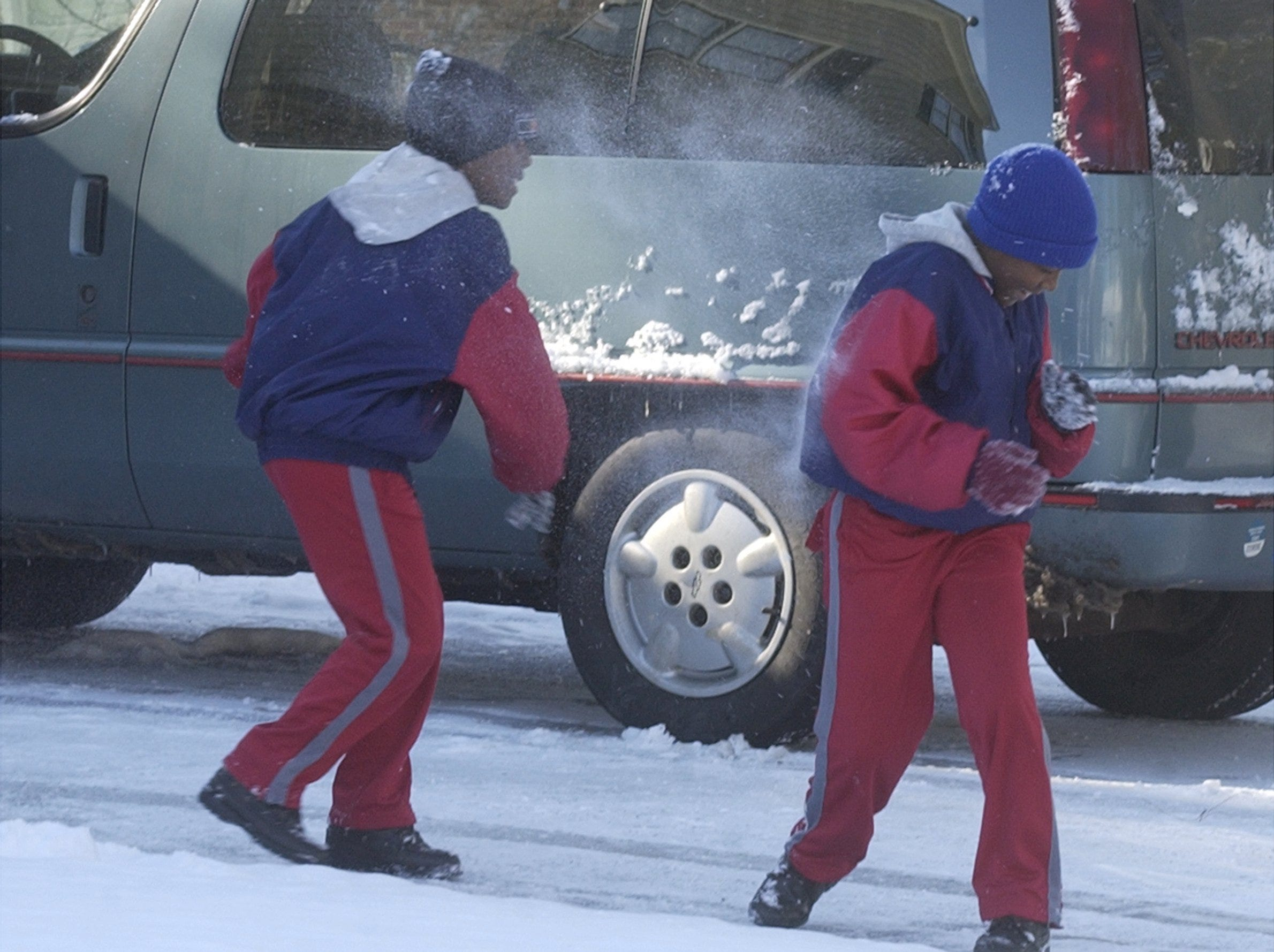 Darvin Washington throws a snow ball at his twin brother Marvin in Simpsonville January 23, 2003.