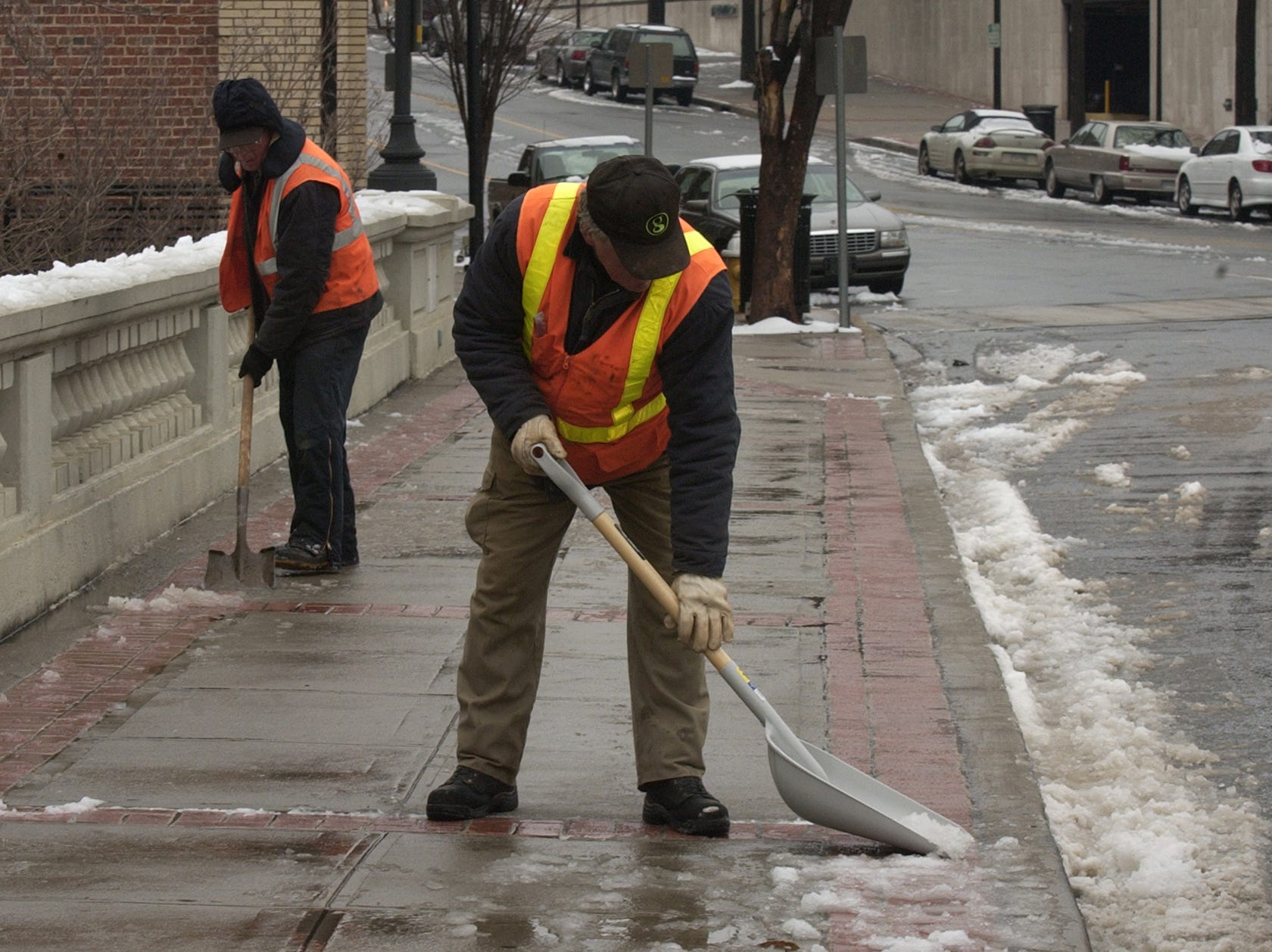 Charles Anderson, left, and Ed Webb, right, shovel snow along Main Street on Thursday, February 1, 2007.