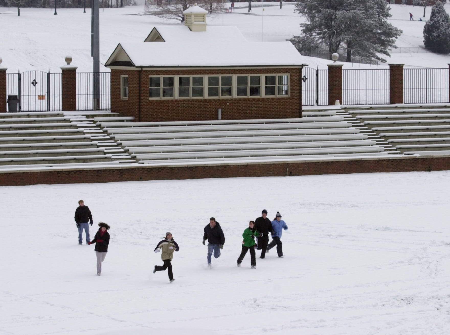 A group of Furman students plays in the snow in the soccer stadium at Furman Thursday, Jan. 3, 2002.