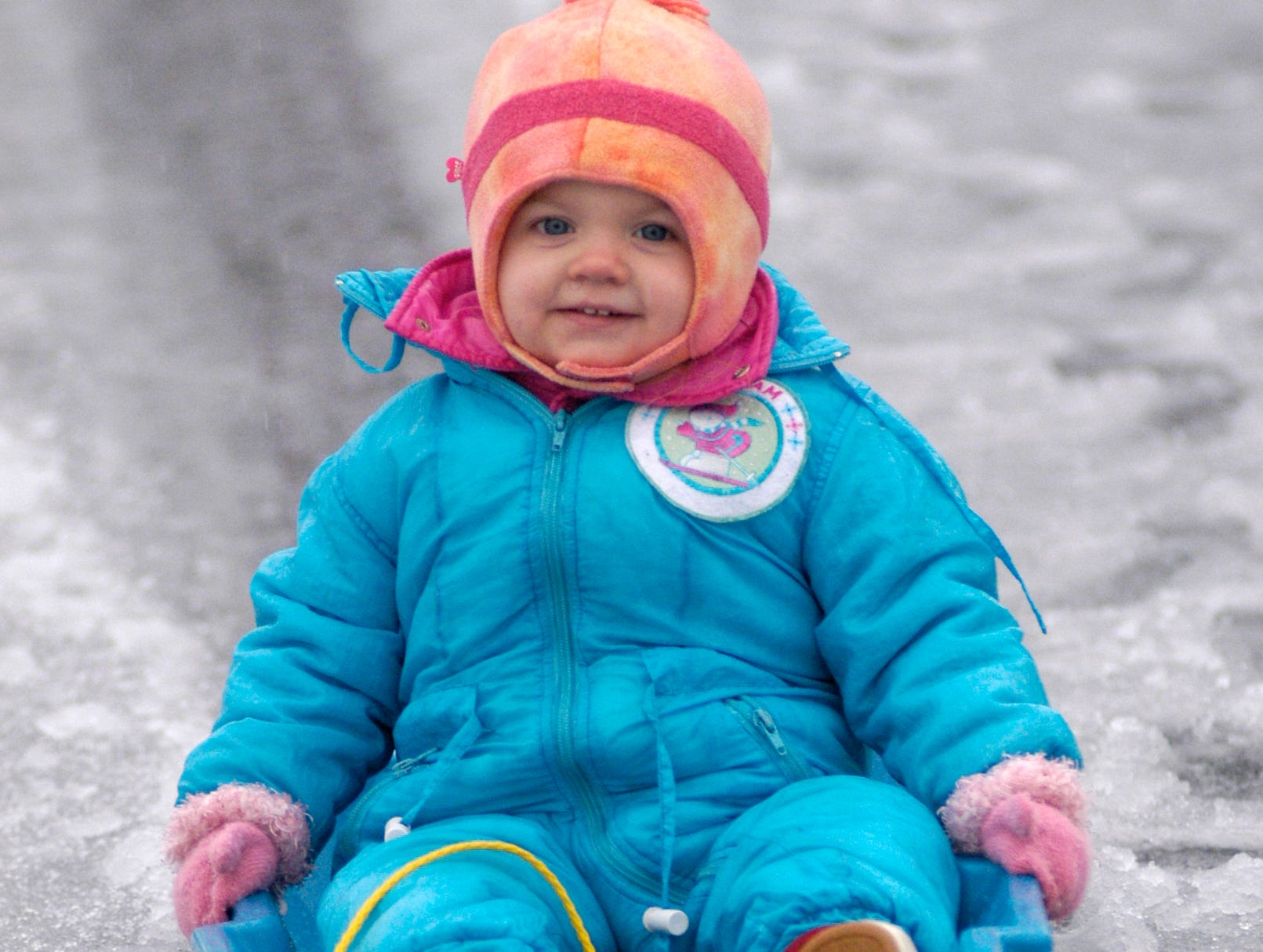 2-year-old sister Mackenzie Joye sleds down a hill in her Mauldin neighborhood. A snowy-ice storm rolled through the Upstate Thursday, February 1, 2007.