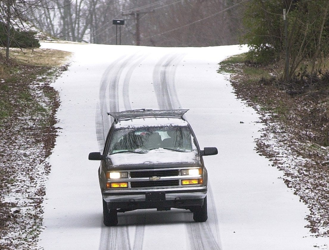 One of the few vehicles out on the morning January 29, 2005 makes its way along North Parker Rd. in Greenville.