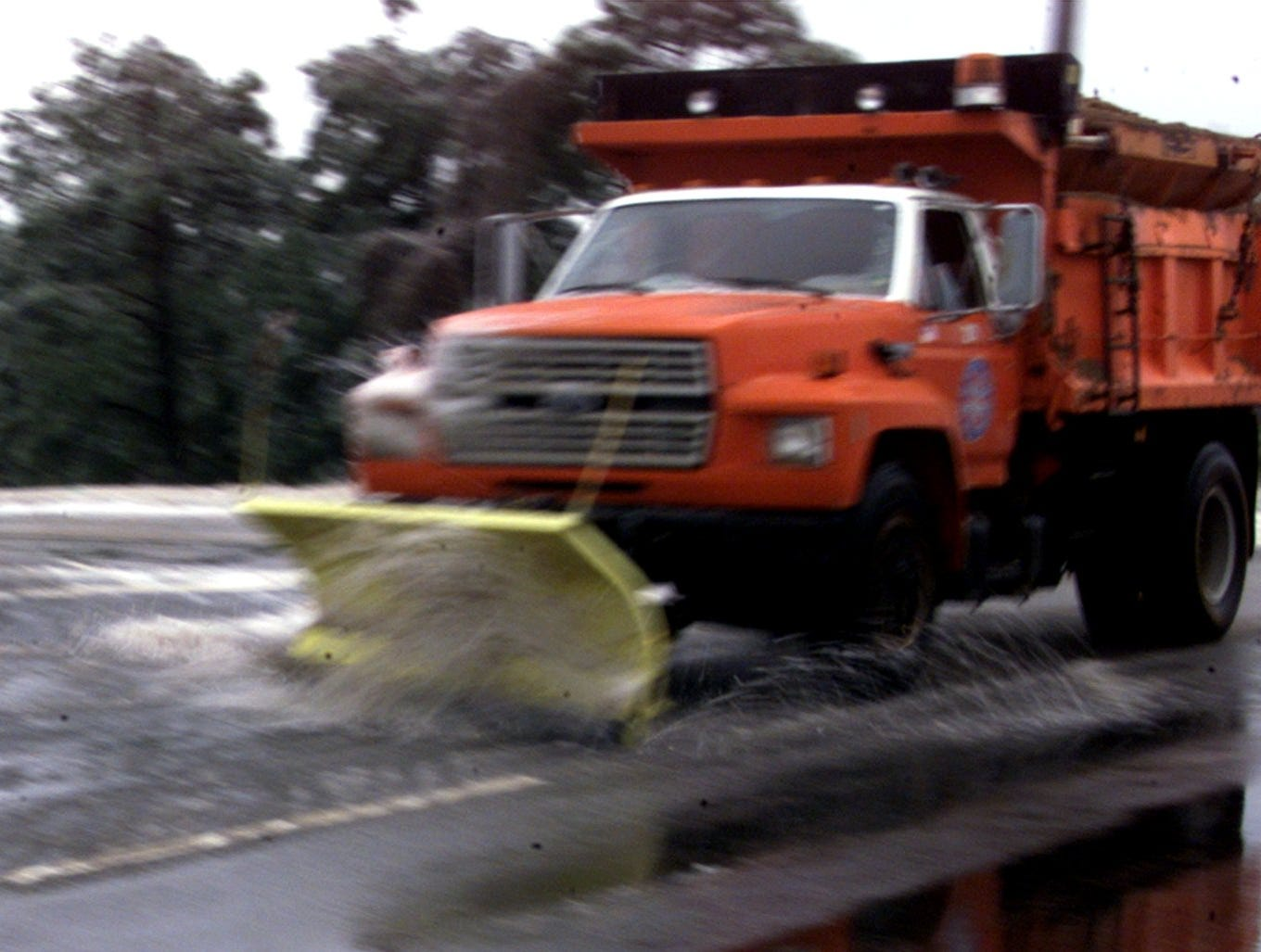 A snow plow on Roper Mountain Road on January 30, 2000.