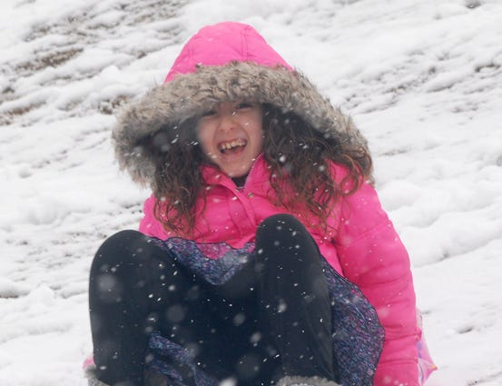 Children spent part of Tuesday enjoying the dusting of snow that fell in the Upstate Tuesday, February 11, 2014.