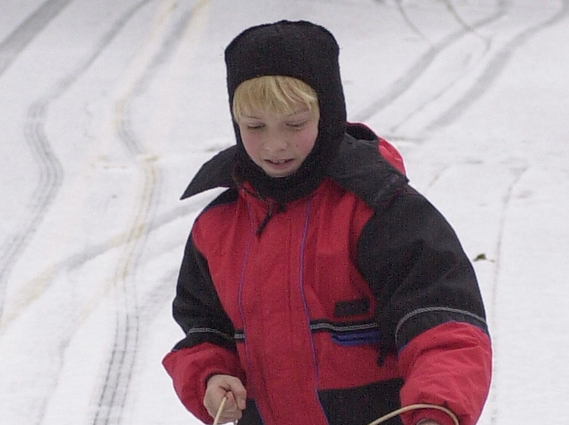 Making tracks on Crestline Rd. is 11 yr. old Philip Reed January 29, 2005.