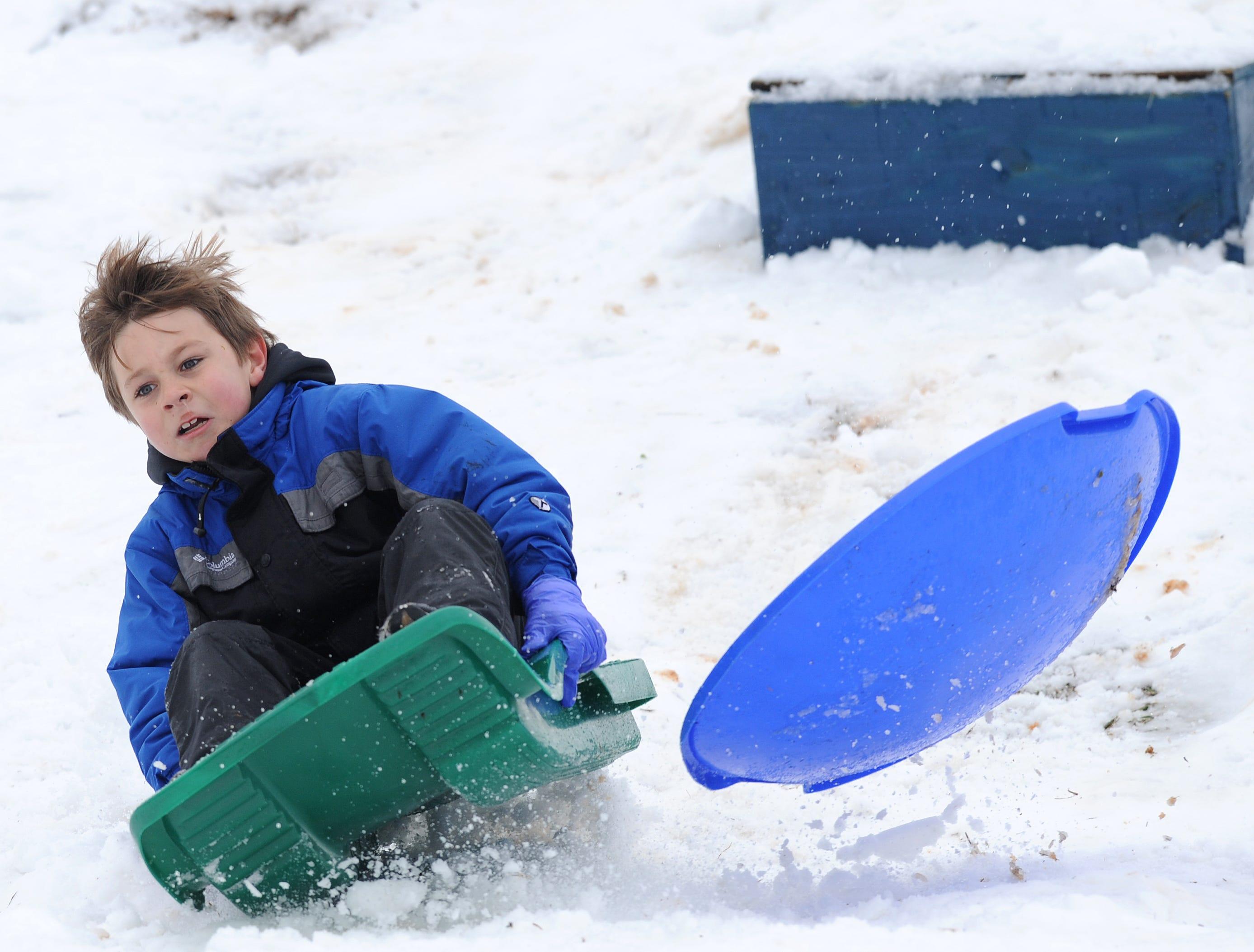 Eli Strickland sleds in Belton Thursday, February 13, 2014.
