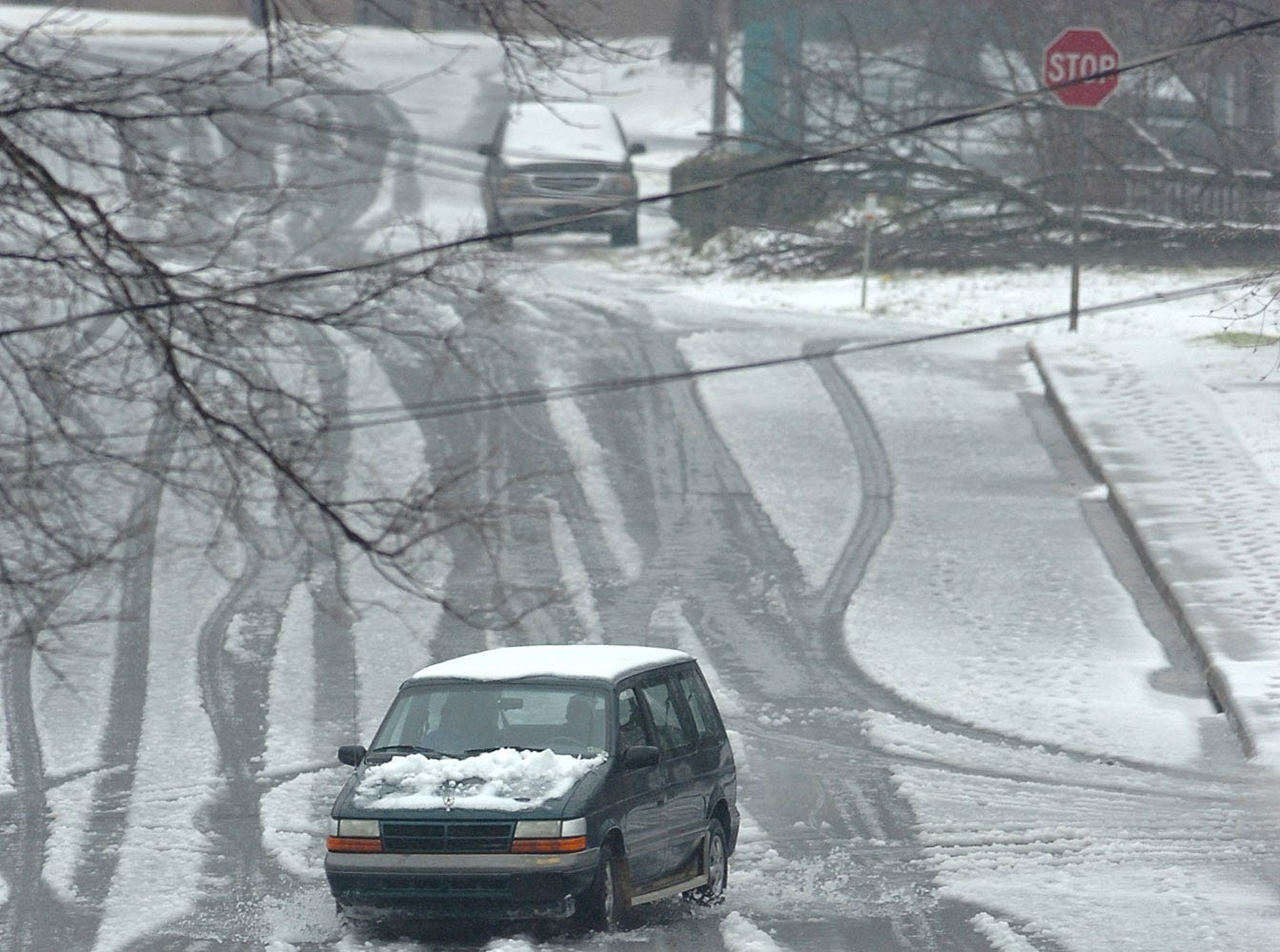 A van is driven down a snow covered Thruston St in downtown Greenville Thursday, February 1, 2007.