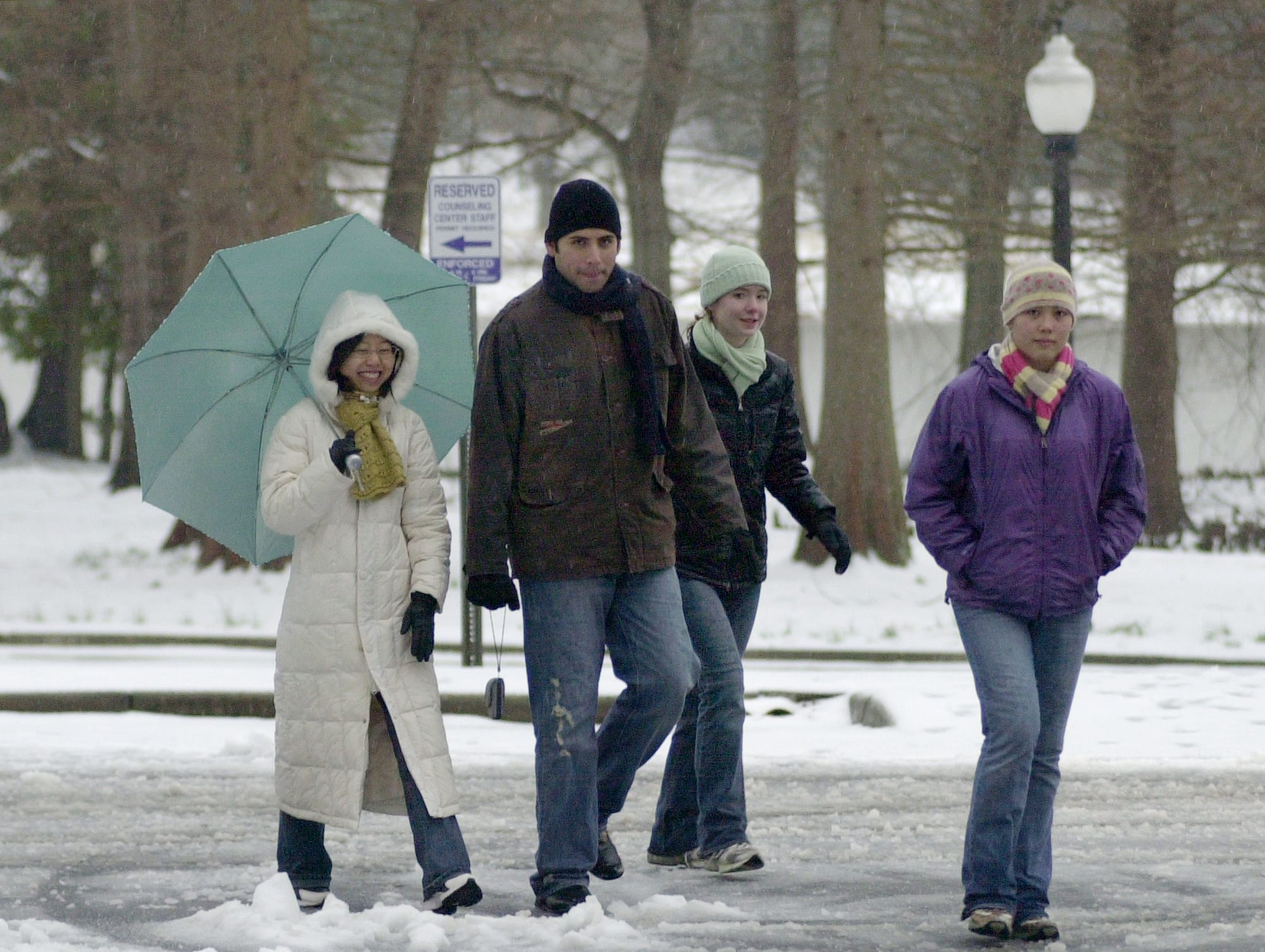 Furman students Jing Zhu from China, David Alvarez from Mexico, Jessica Brown  and Carol Conlin (both from Greenville (left to r.) make their way about the snow covered campus 2/1/07. This was David's first encounter with snow.   Furman had no school today due to the inclement weather.